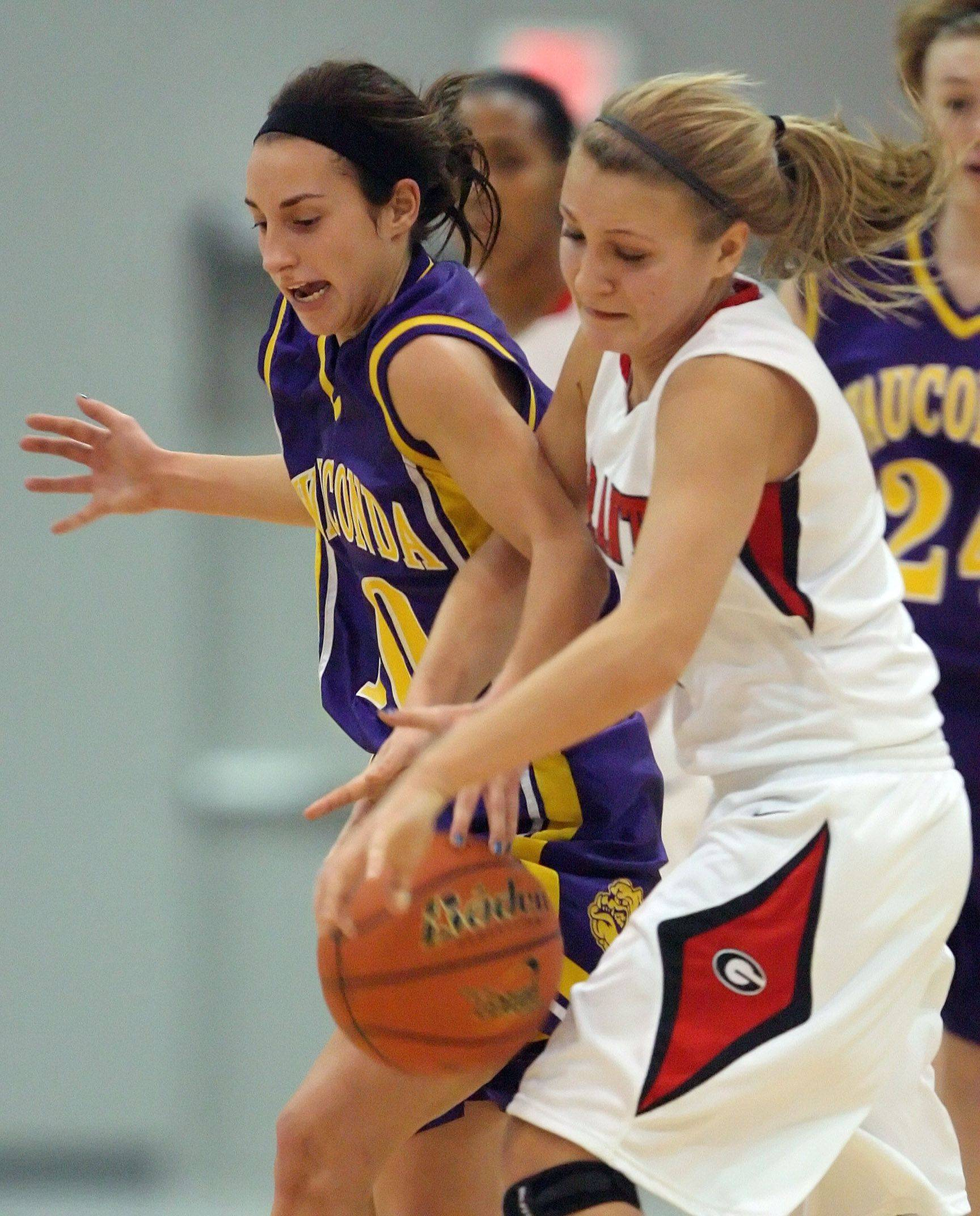 Wauconda's Melanie Prudhomme, left, and Grant's Morgan Jahnke battle for a loose ball Tuesday in Fox Lake.