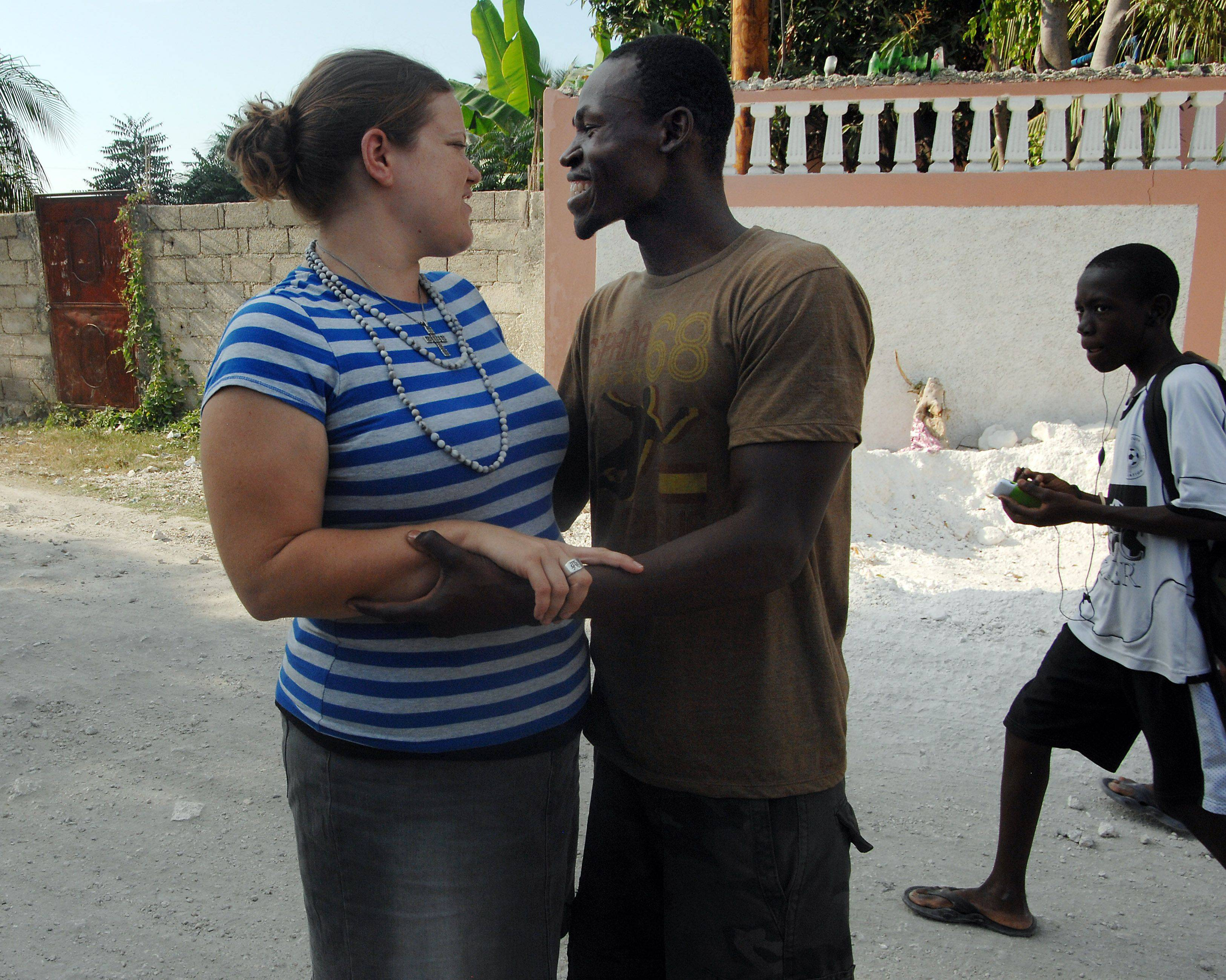 Lionel Legoute, formerly of Palatine, and his fiancee Rachel Ehrhard of Oak Park share a moment in Port-au-Prince on Tuesday. The two met in Chicago at Concordia University and do mission work together. Lionel stayed with the Steve and Janice Schorter family of Palatine while he was in school.