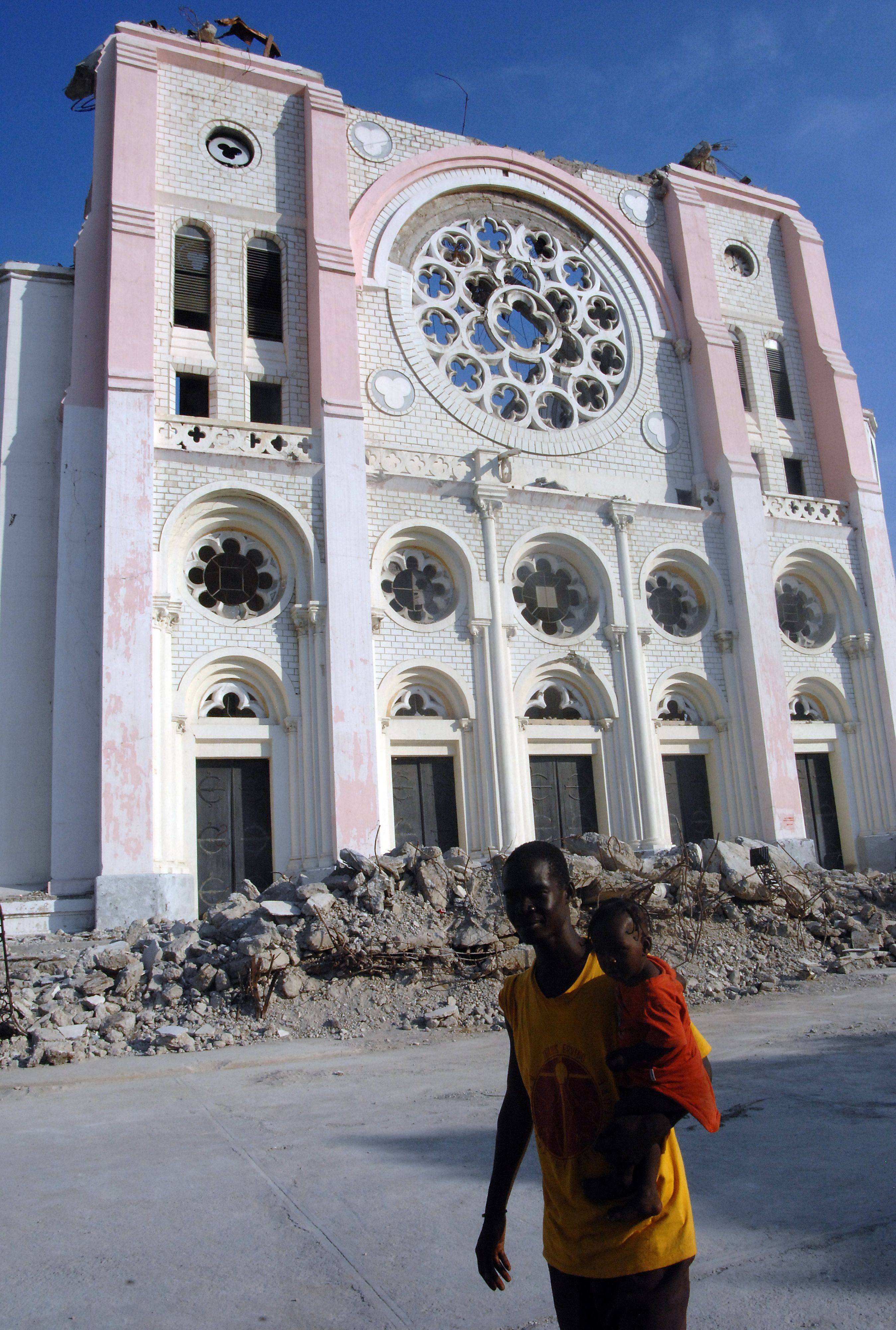 Haitians walk by the remains of Port-Au-Prince Cathedral in one of the hardest-hit areas of Haiti.