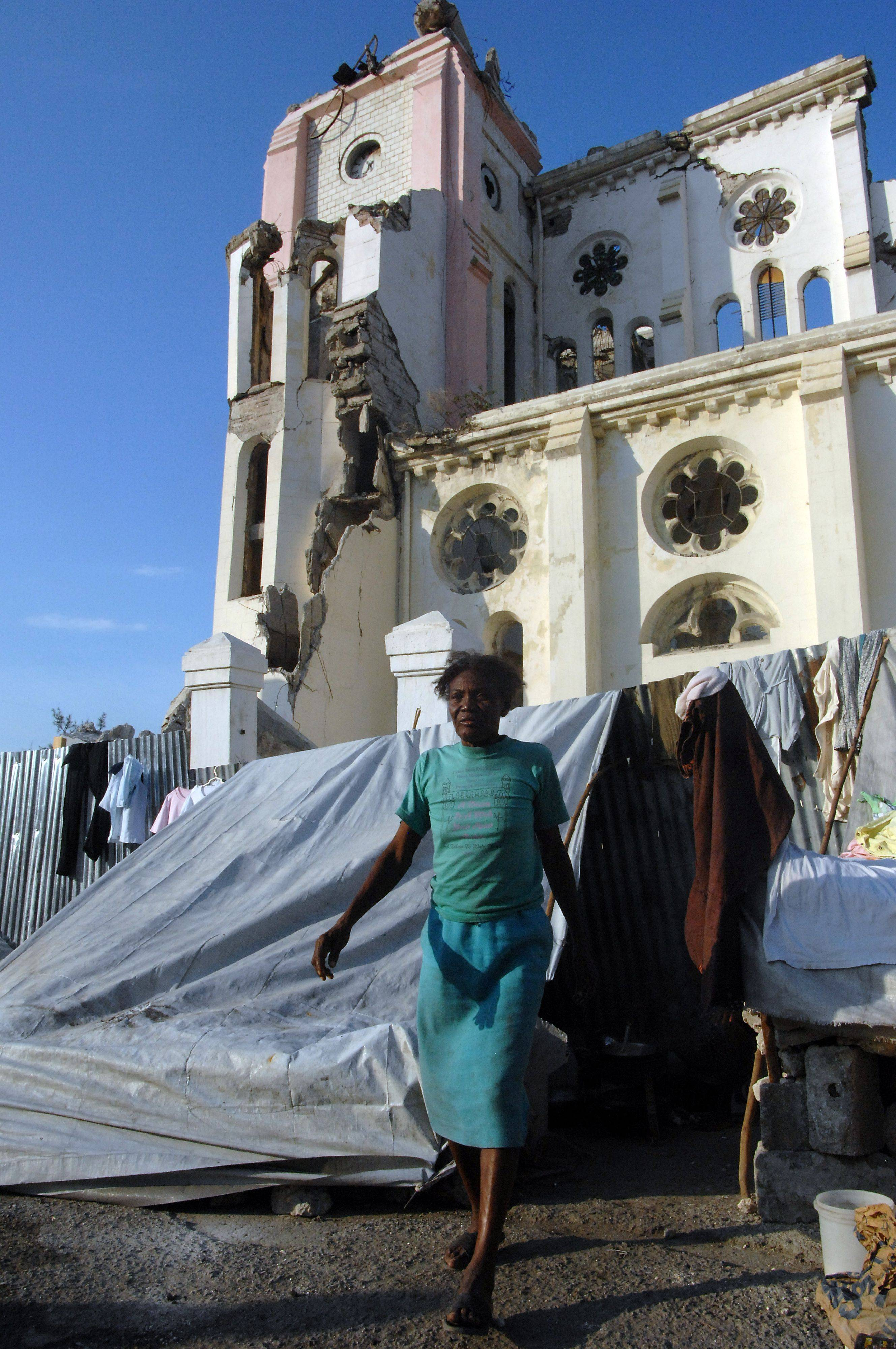 Haitians arrange their homes around the remains of the Port-au-Prince Cathedral .