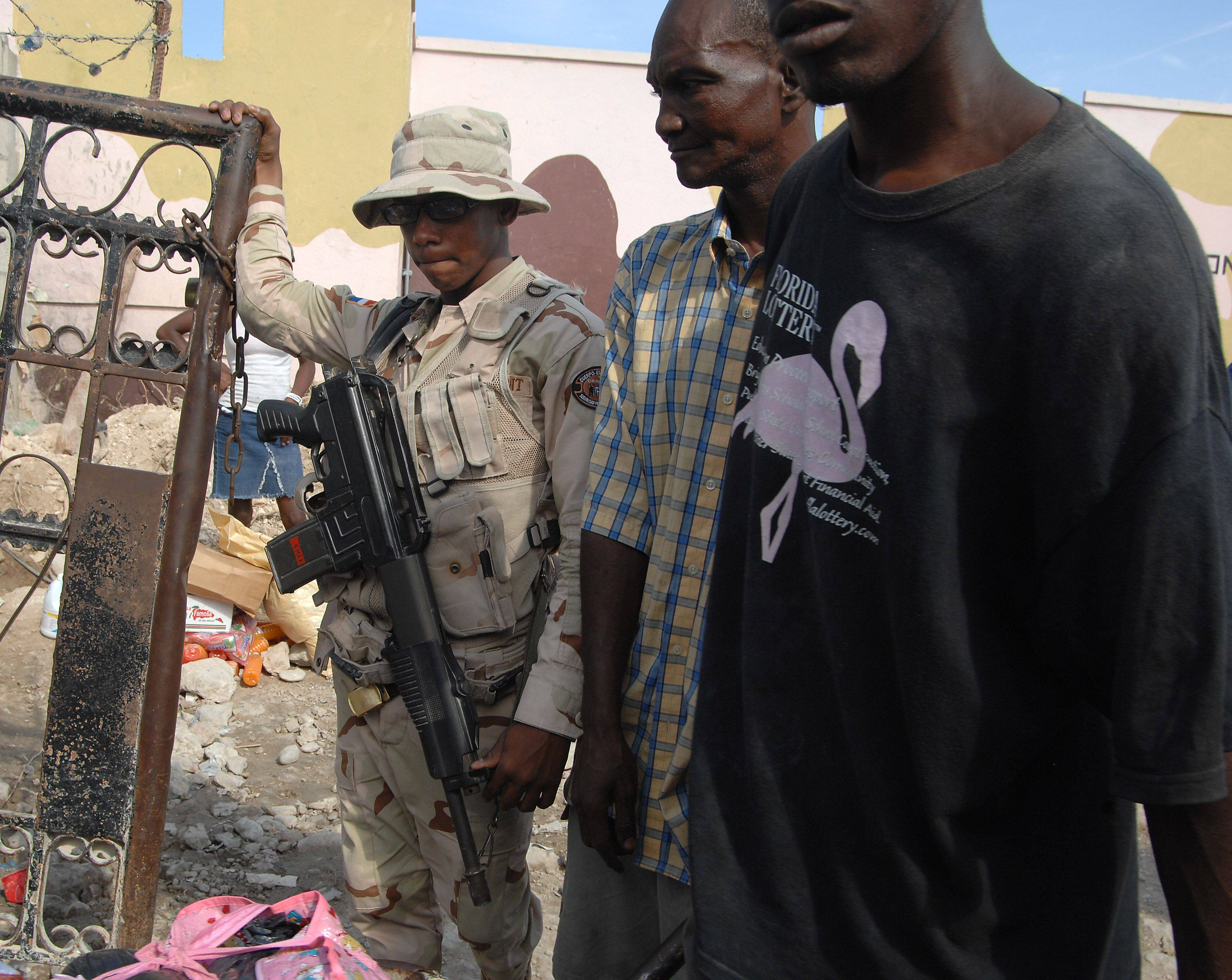 Armed border guards at the boundary of Haiti and the Dominican Republic keep the peace.