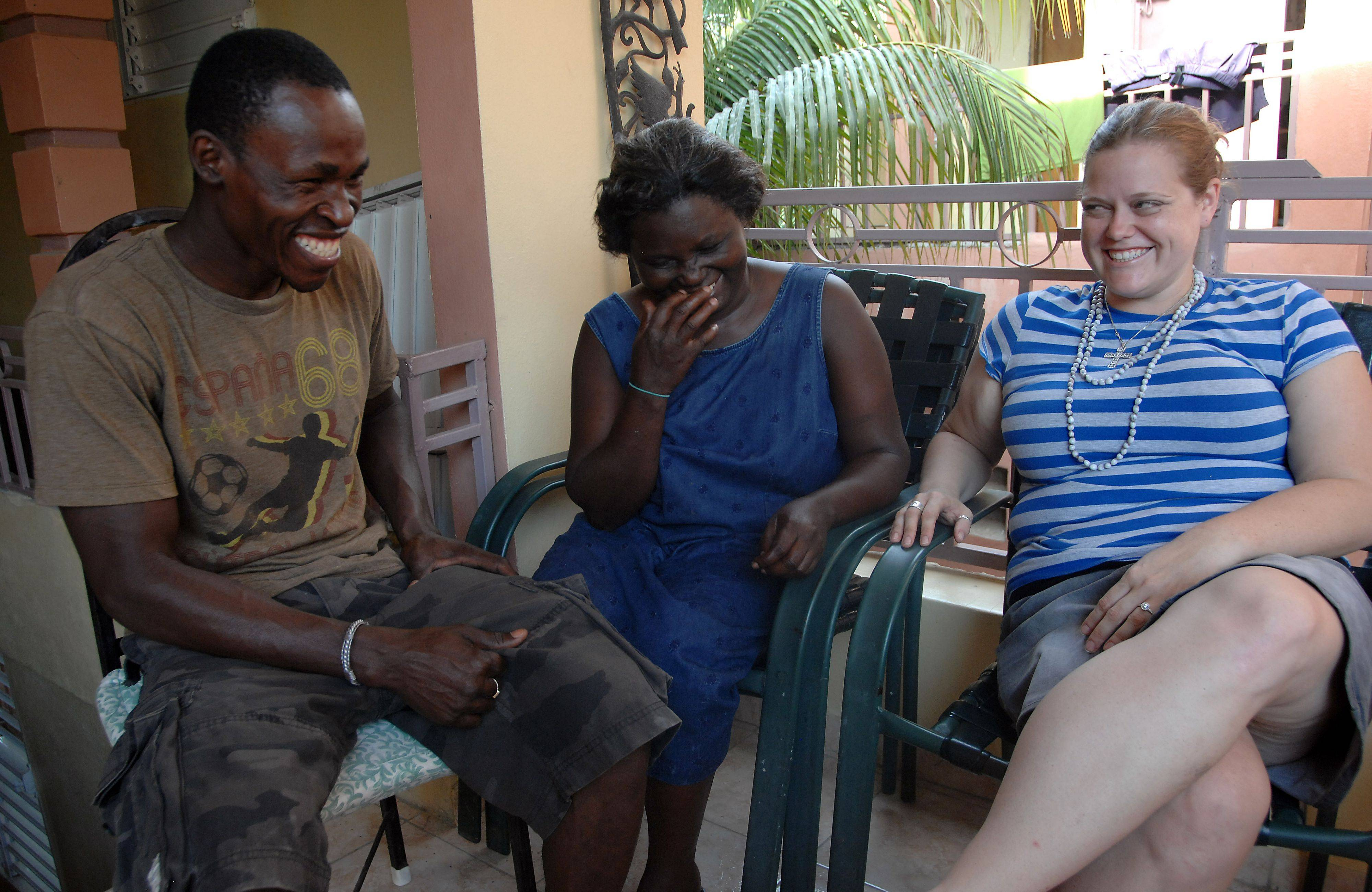 Lionel Legoute, formerly of Palatine, and his fiancee Rachel Ehrhard of Oak Park shares a moment with Port-au-Prince resident Madam Venia Jean Baptiste in Port-au-Prince, Haiti talking about the earthquake and how it changed their lives.