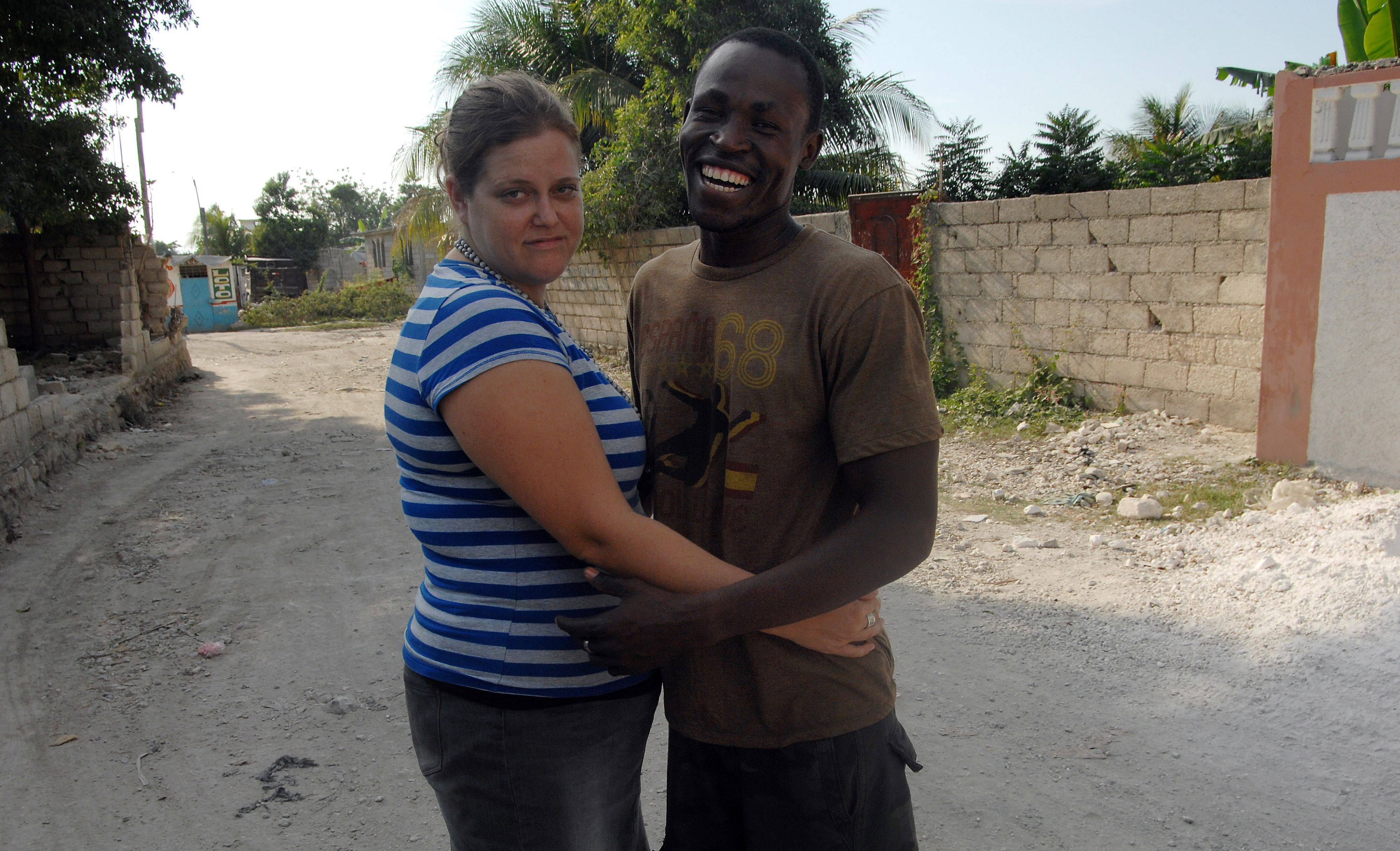 Lionel Legoute, formerly of Palatine, and his fiancee Rachel Ehrhard of Oak Park share a moment in Port-au-Prince on Tuesday.