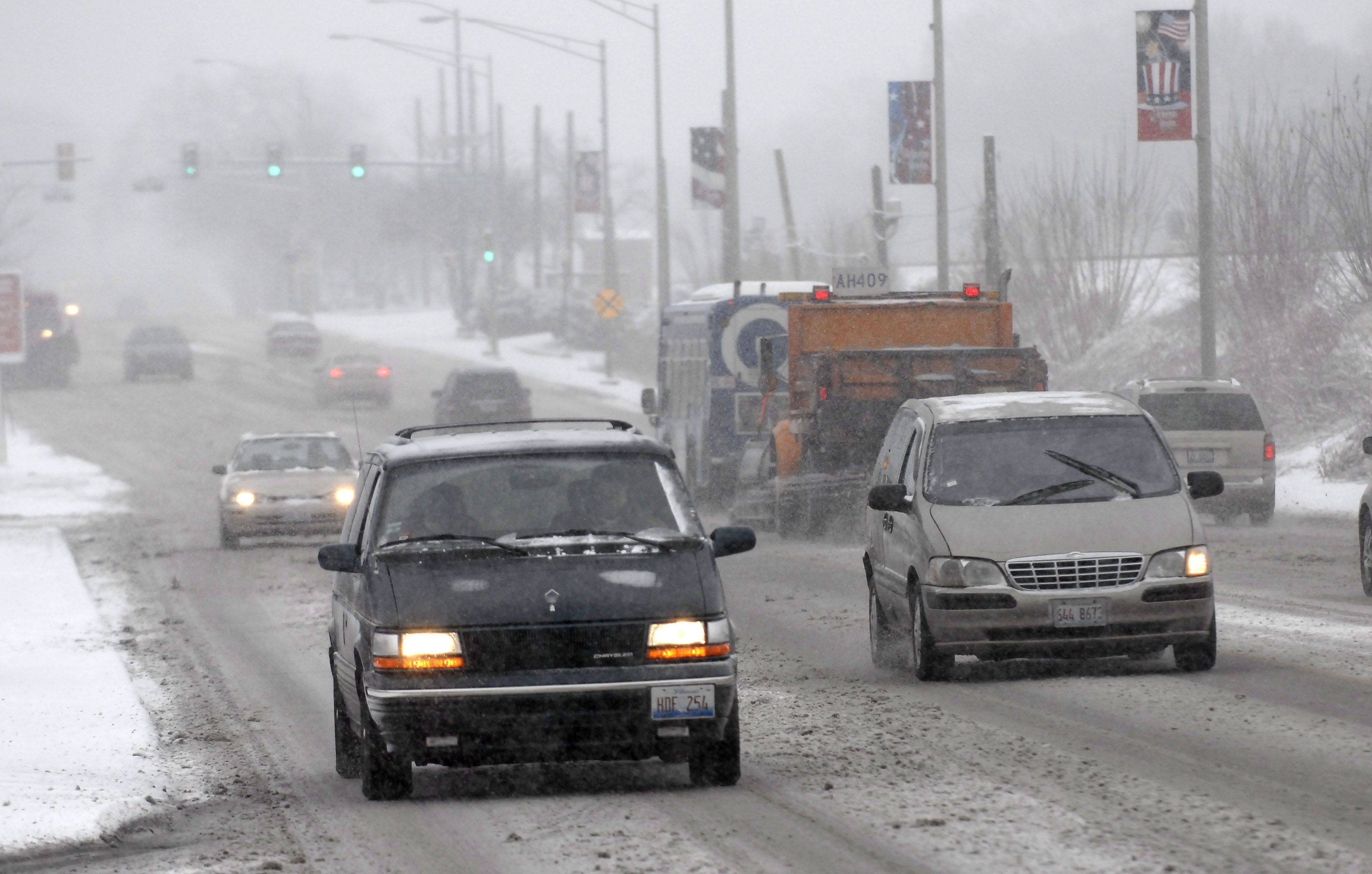 Drivers were slowing down a bit on Northwest Highway when snow continued to fall after a few fluffy inches accumulated Tuesday morning in Arlington Heights.