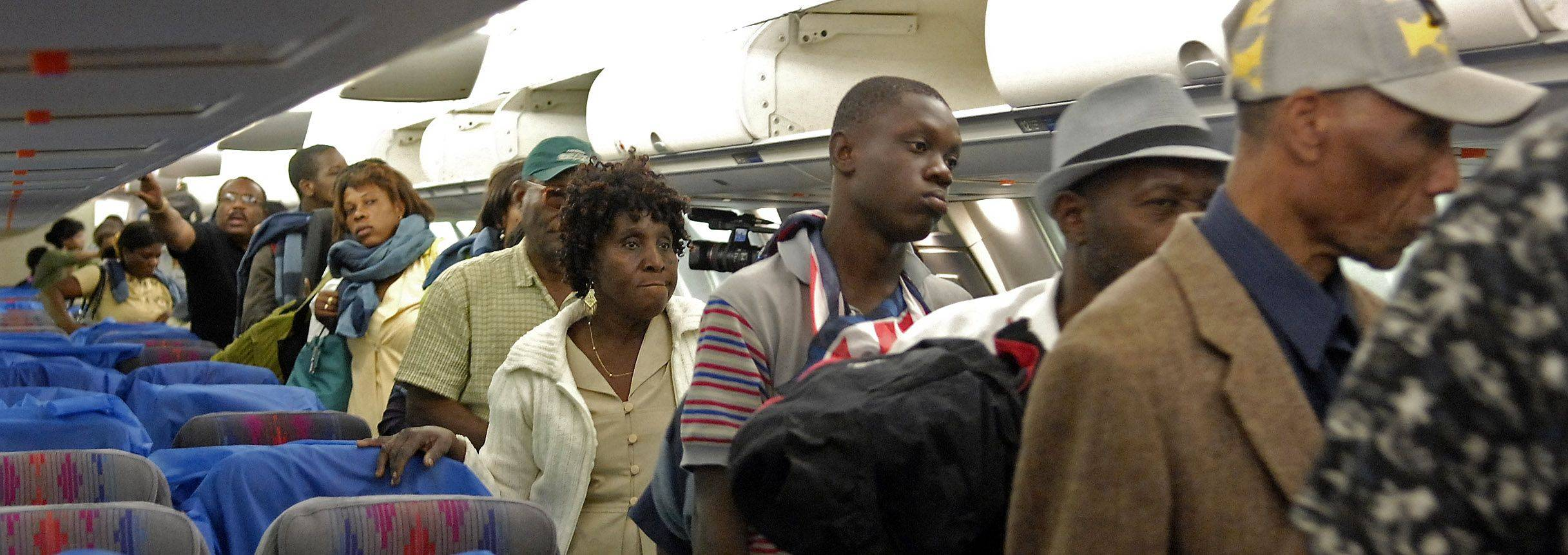 Evacuees from Haiti deplane in Chicago Wednesday night.