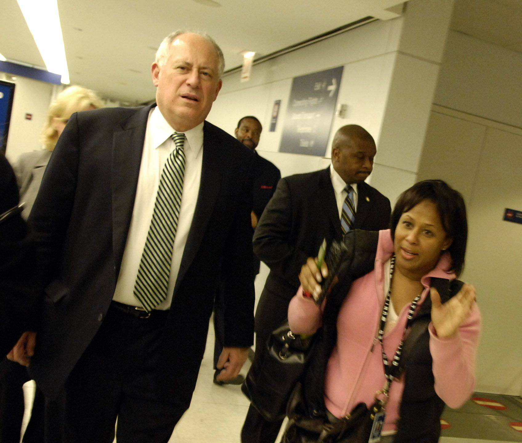 Governor Pat Quinn talks with United Airlines' Sonya Jackson after United's relief trip to Haiti.