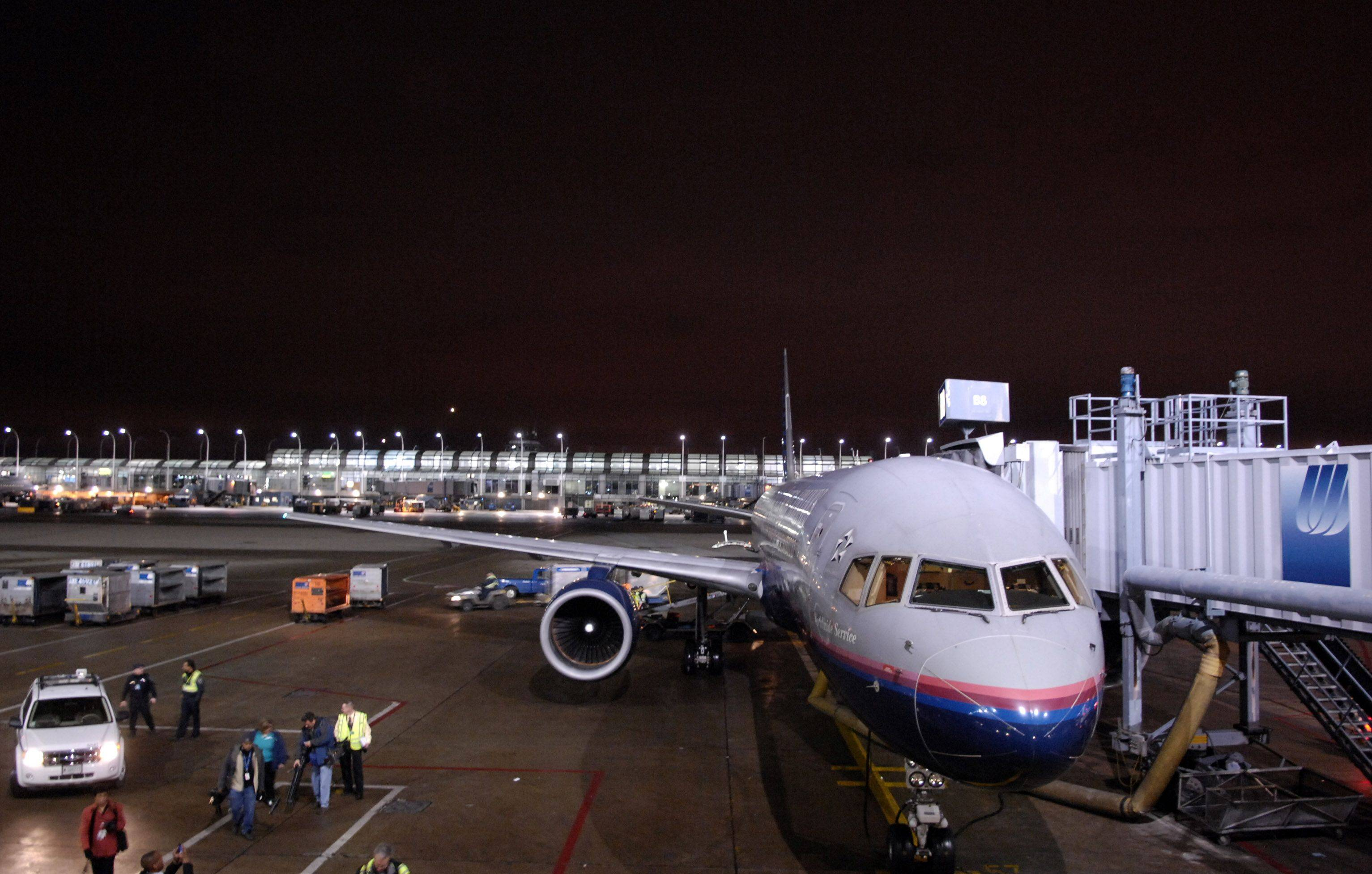 United Airlines loads its first relief flight to Haiti with cargo from Walgreens as well as other companies and relief groups. Relief workers are headed there as well.