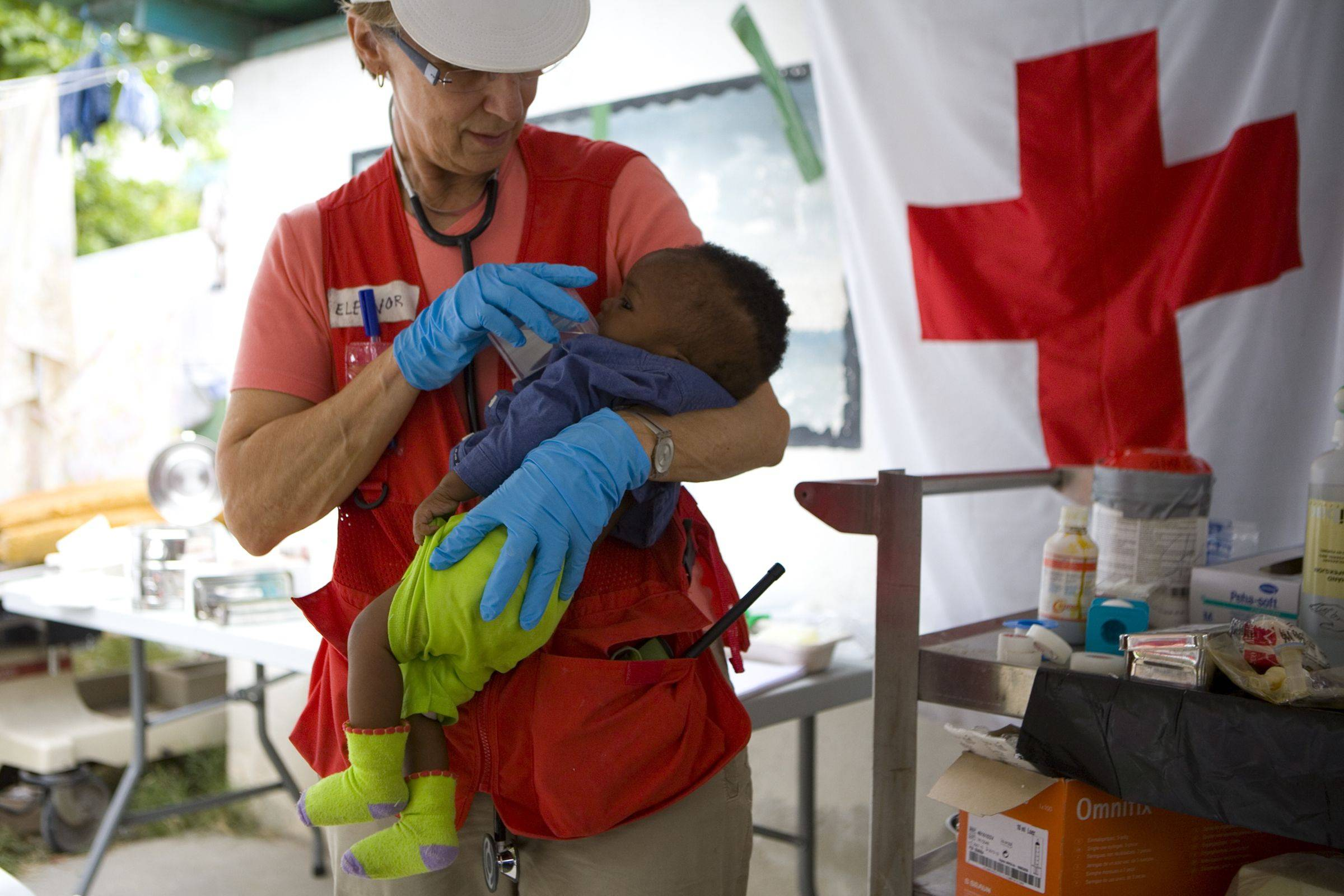 In this Jan. 19, 2010 photo provided by the American Red Cross, Eleanore Rose of the Canadian Red Cross holds six-month-old Sebastian Joseph at Hospital General in Haiti. Sebastian�s mother was killed in the Jan. 12 earthquake. For the American Red Cross, a surge of donations to help its relief efforts in Haiti provides a dramatic chance to prove it learned from its flawed responses to Hurricane Katrina and the 9/11 terror attacks.