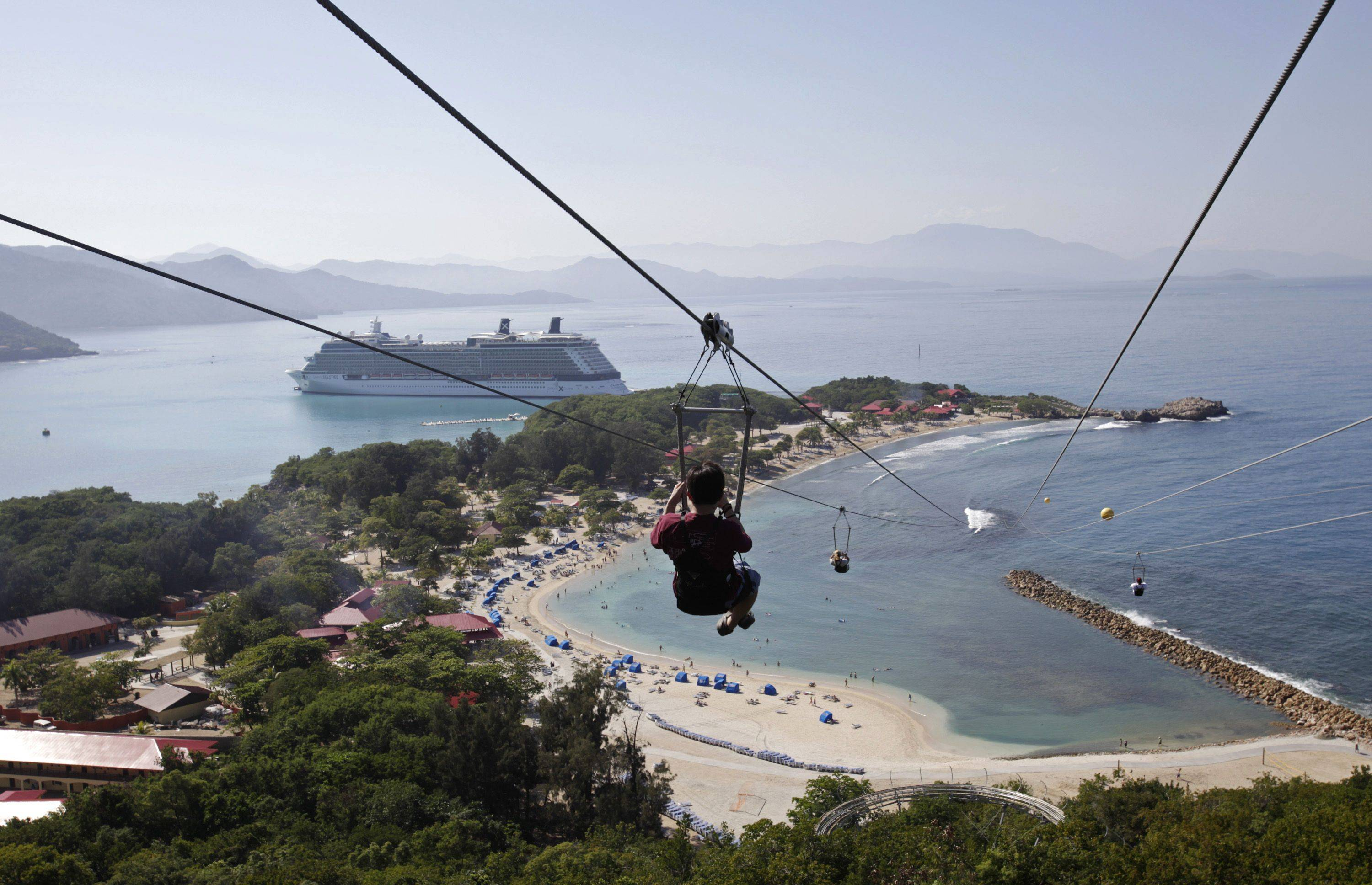 Passengers from the Celebrity Cruises ship Solstice zipline in Labadee, Haiti, Friday, Jan. 22, 2010. Cruise ships continued to stop at the Labadee resort after a 7.0-magnitude earthquake struck Haiti on Jan. 12.