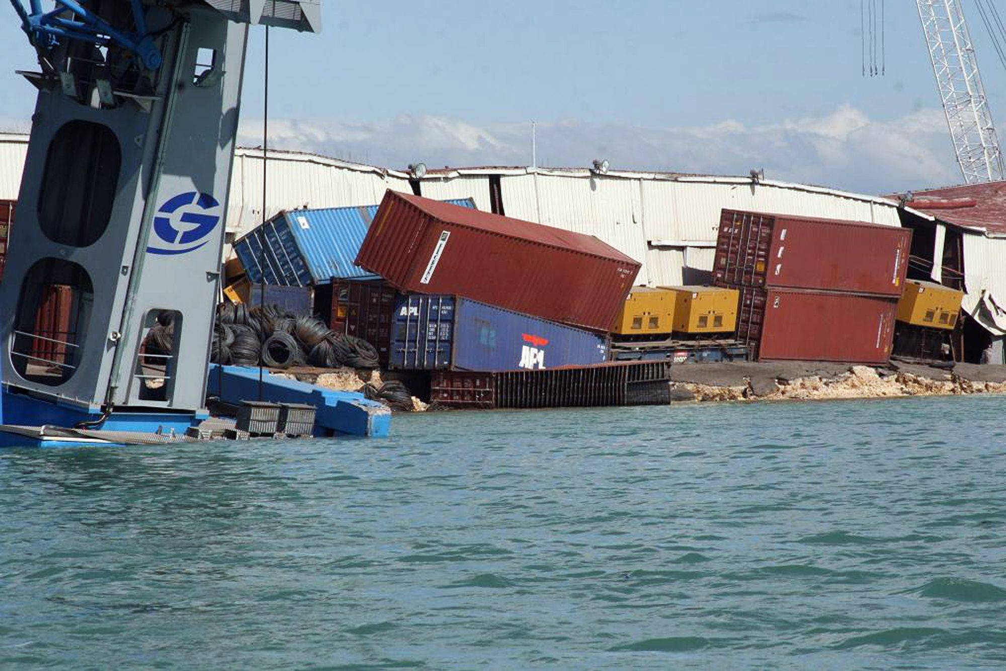 In this photo provided by the U.S. Coast Guard, containers are toppled over in the port of Port-au-Prince, Haiti, Wednesday Jan. 13, 2009 after an earthquake struck the region.