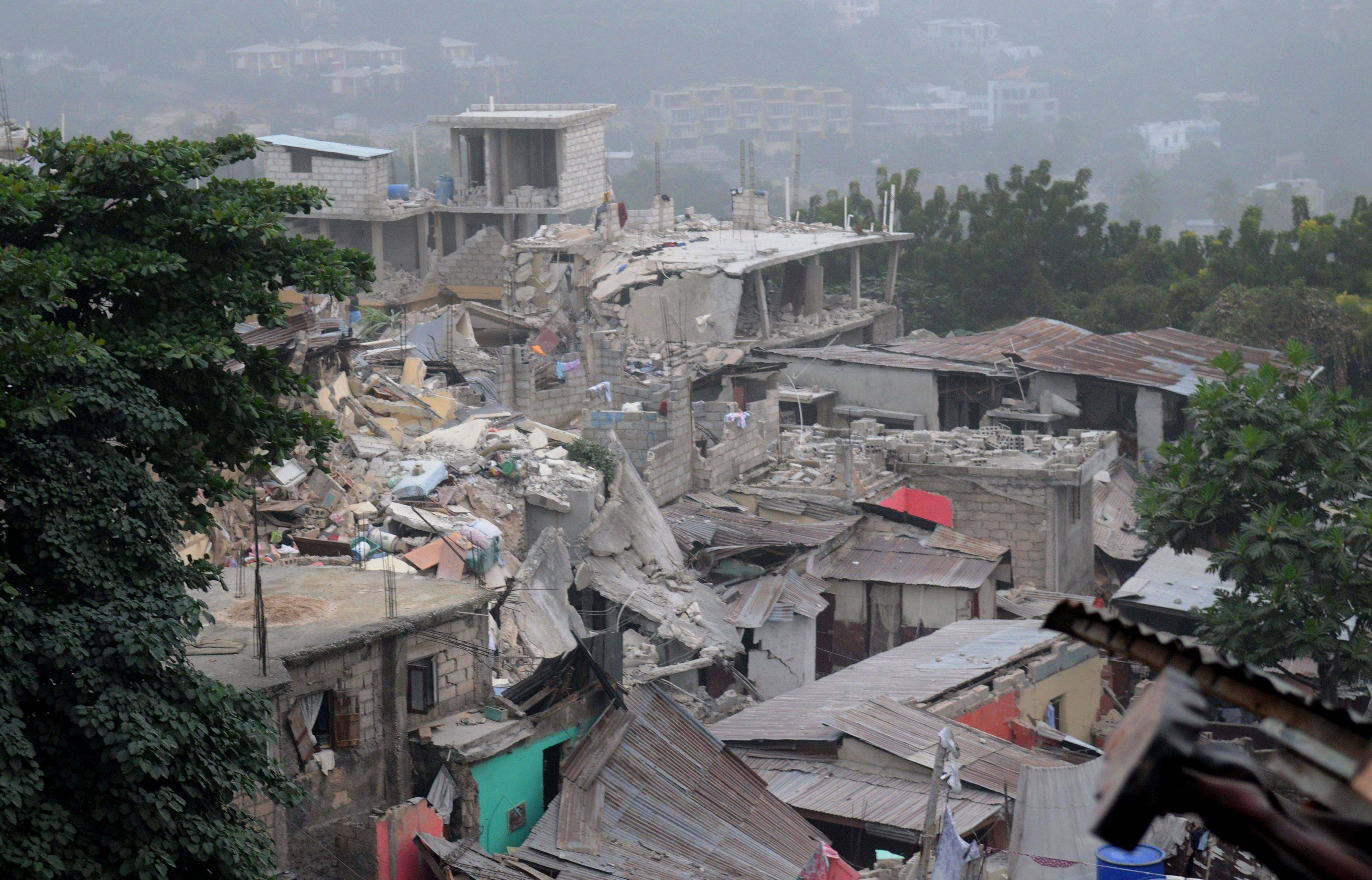 Homes affected by an earthquake are seen in Port-au-Prince, Haiti, Wednesday, Jan. 13, 2010.