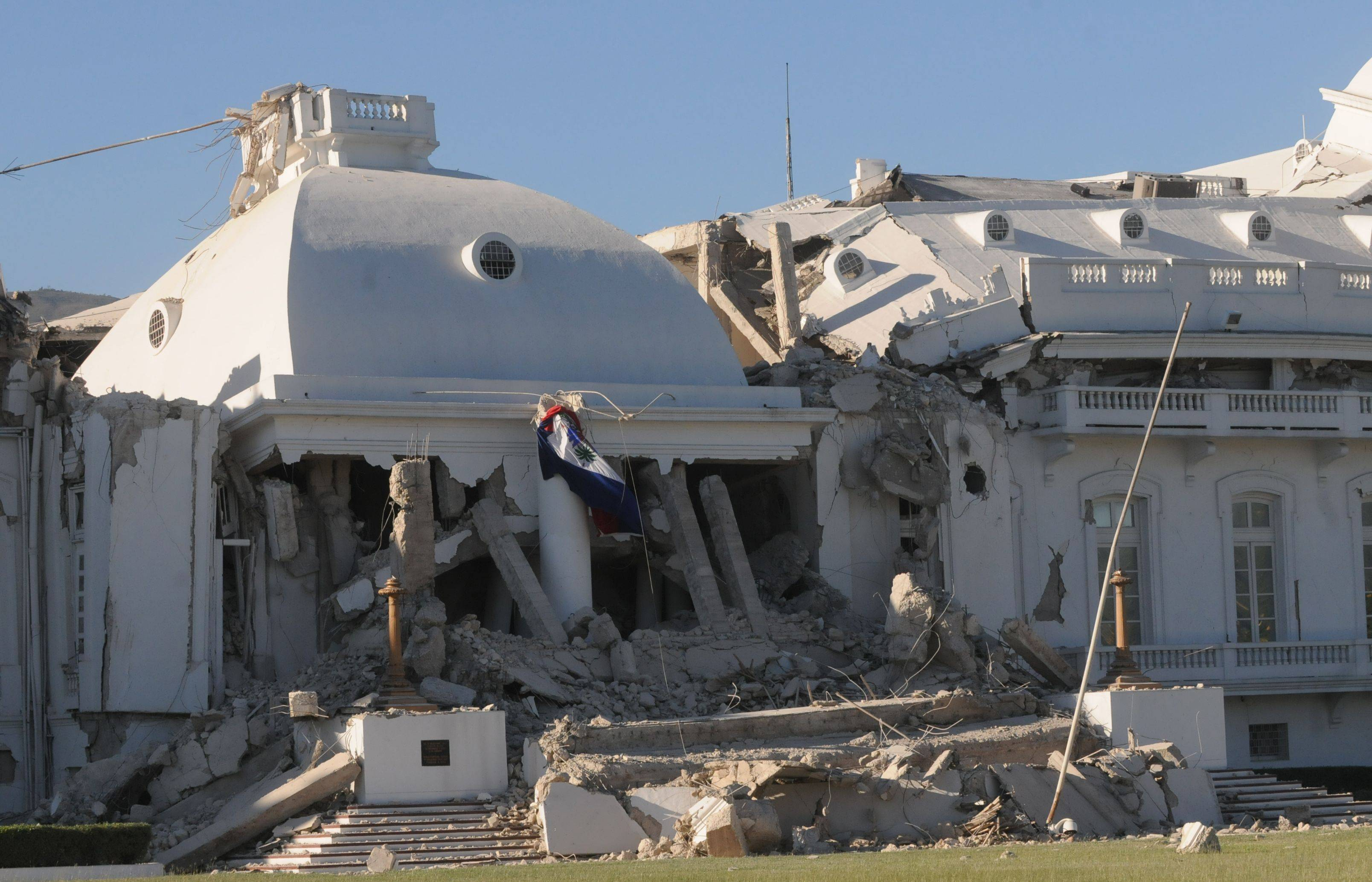 Haiti's National Palace is seen damaged in Port-au-Prince, Wednesday, Jan. 13, 2010 after a powerful earthquake struck the country.