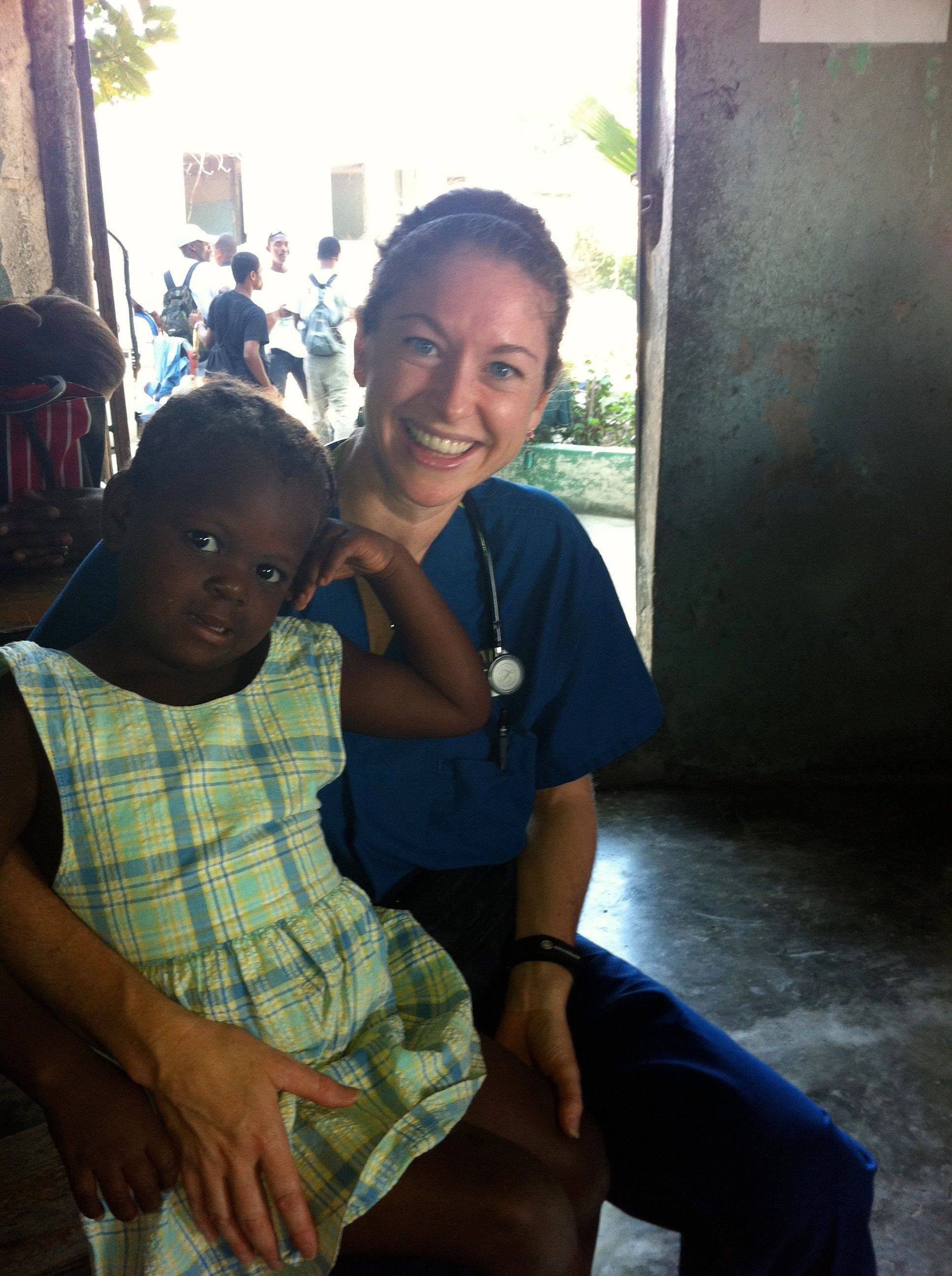 Dr. Kathleen Moline of Central DuPage Physician Group holds a little girl in Haiti. Many of the children had ailments that would have been easily treated if they had been able to get to a doctor.