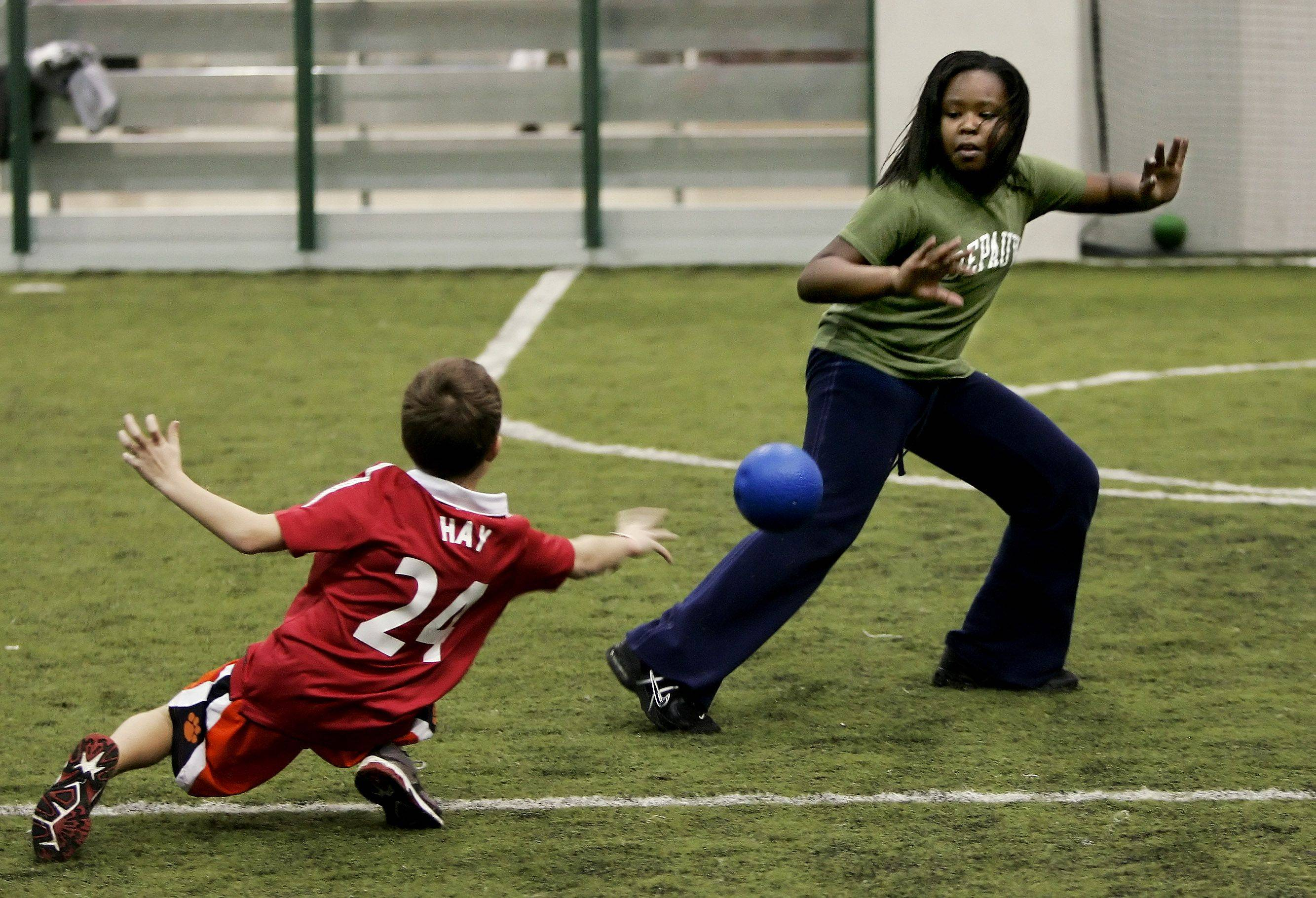 Chelsea Eppinger, 11, of Gurnee tries to avoid the throw of another player during dodgeball at the Libertyville Sports Complex. Experts say exercise is important in combating disease and keeping a positive attitude.