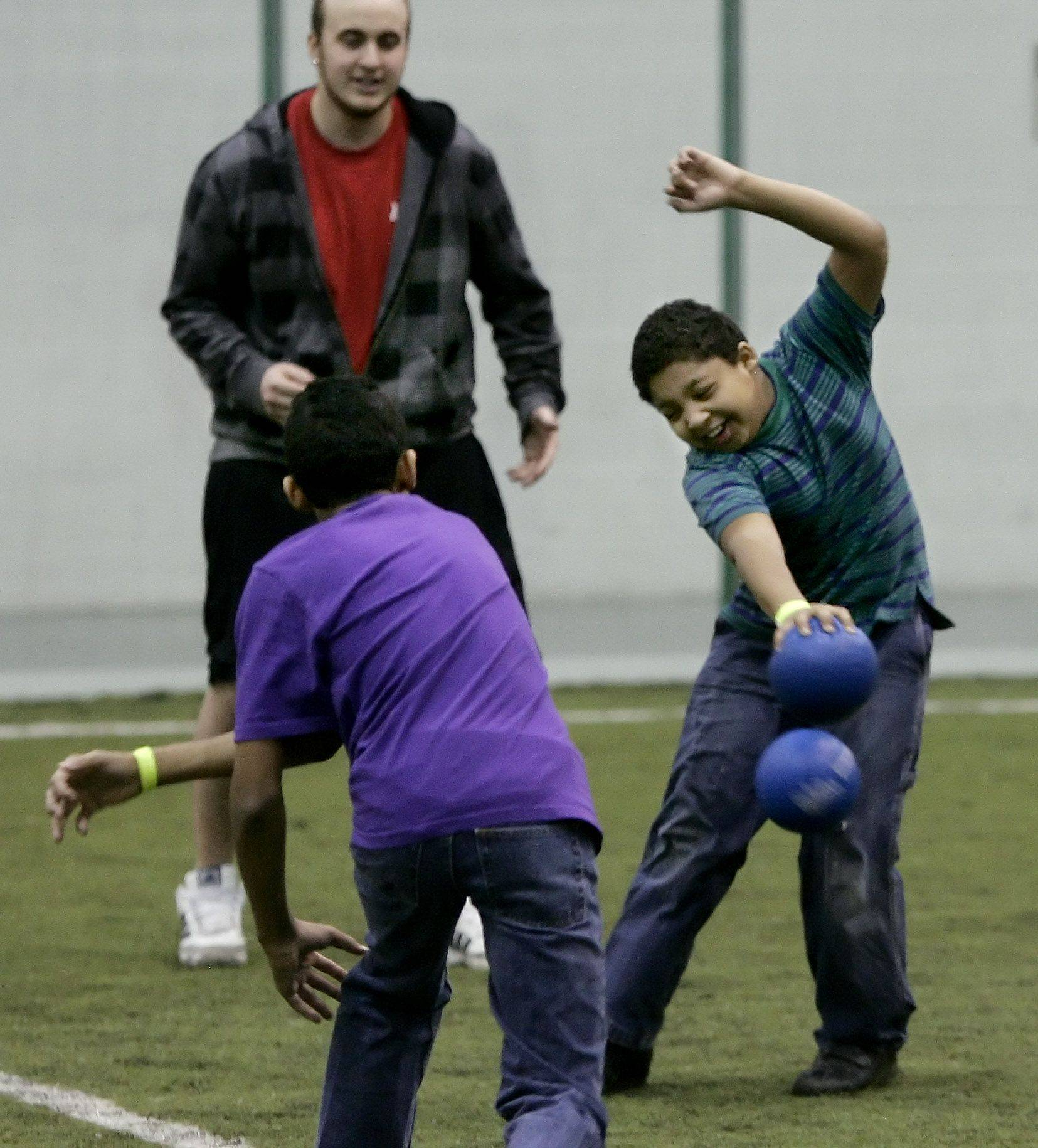 Adrian Garcia, 9, is hit by a throw from Andrew Lewis, 13, as the boys, both of Gurnee, play dodgeball during Open Gym Week last month at the Libertyville Sports Complex. The fitness center offered a host of activities during winter break to keep students active.