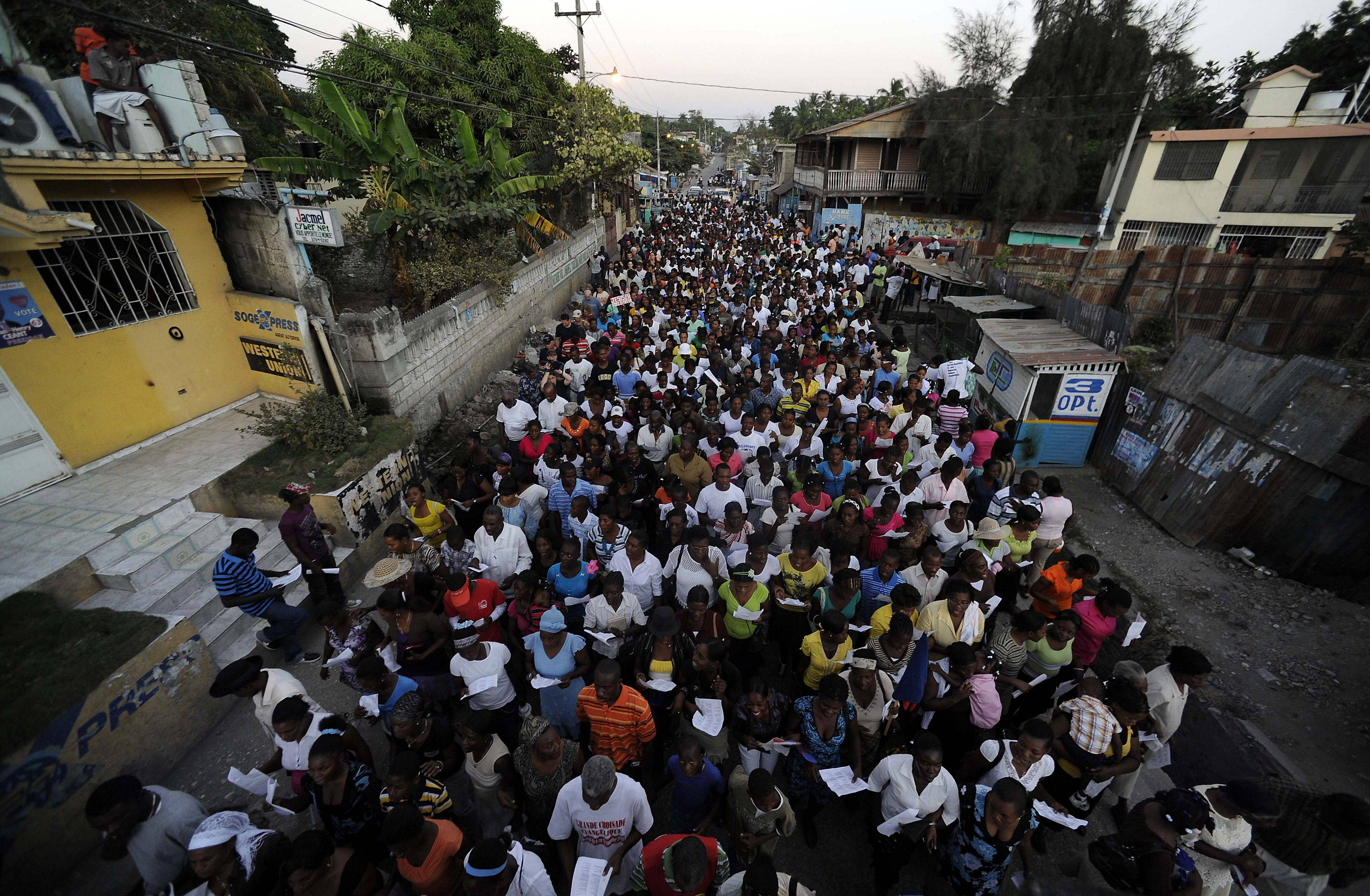 Thousands march through the streets of Jacmel, Haiti singing and praying as they mark the one-year anniversary of the massive earthquake .