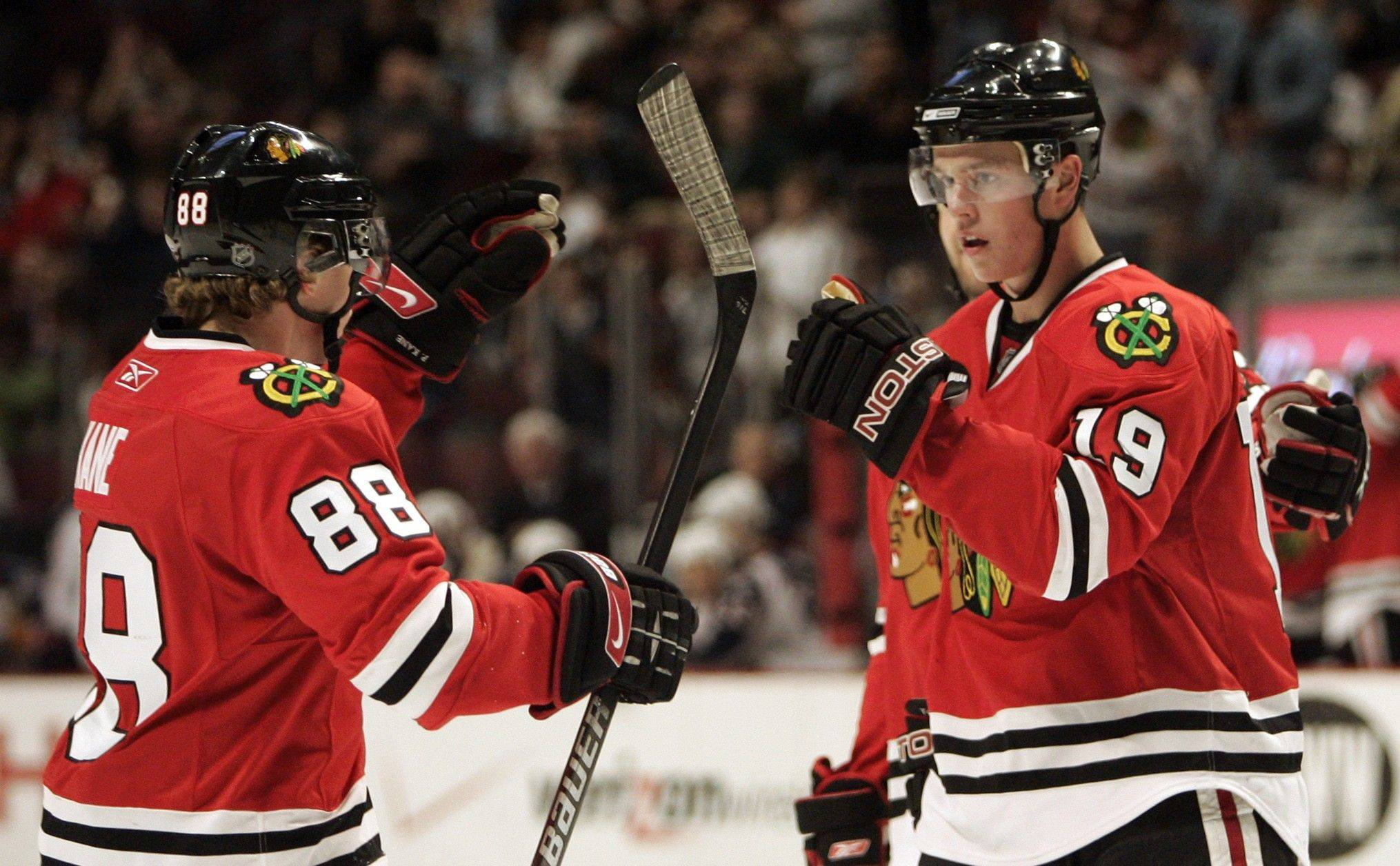 Chicago Blackhawks' Jonathan Toews, right, celebrates a goal with teammate Patrick Kane.
