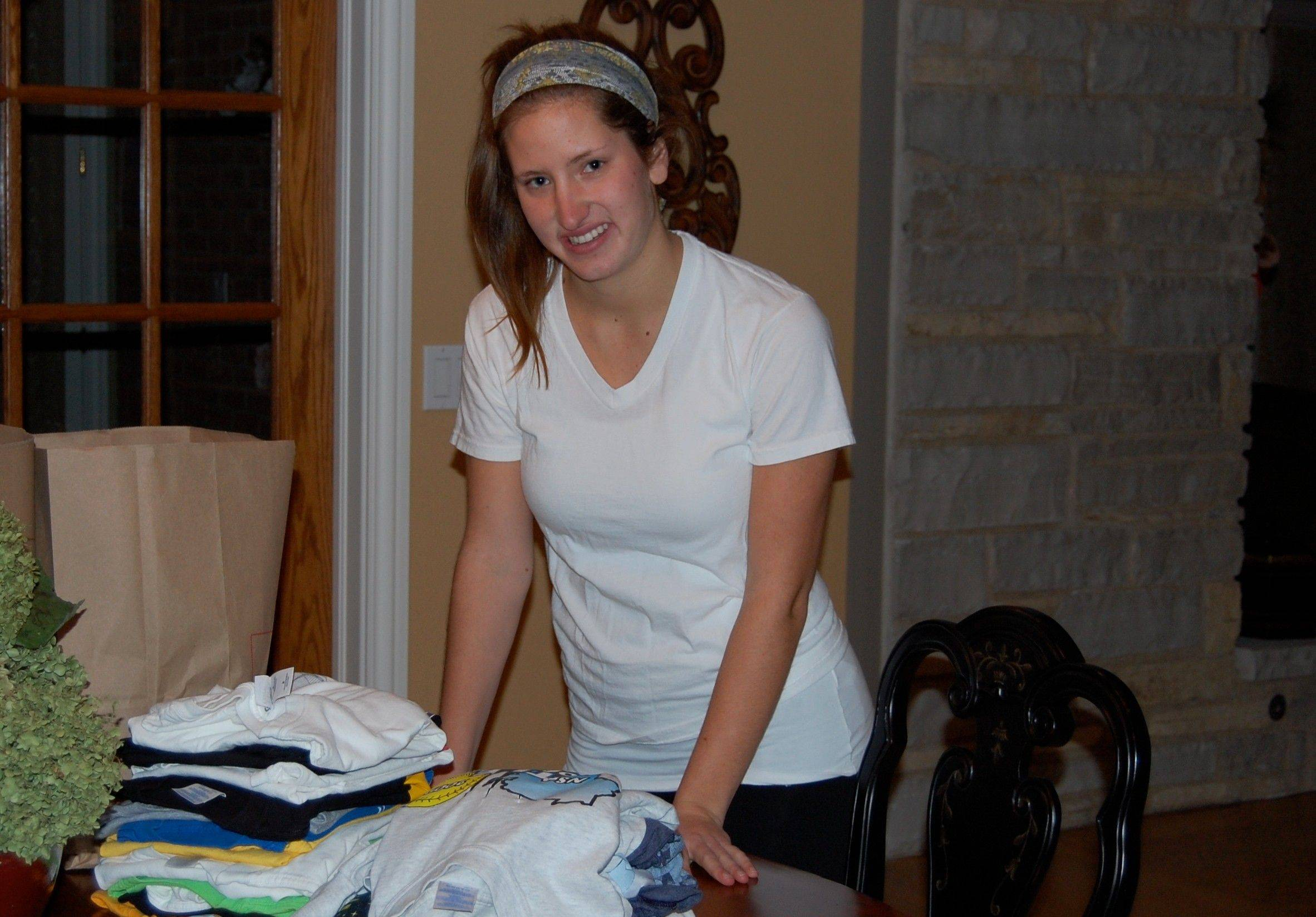 Kayla Mueller folds T-shirts for a National Honor Society service project to benefit children in need in Jamaica and Colombia.