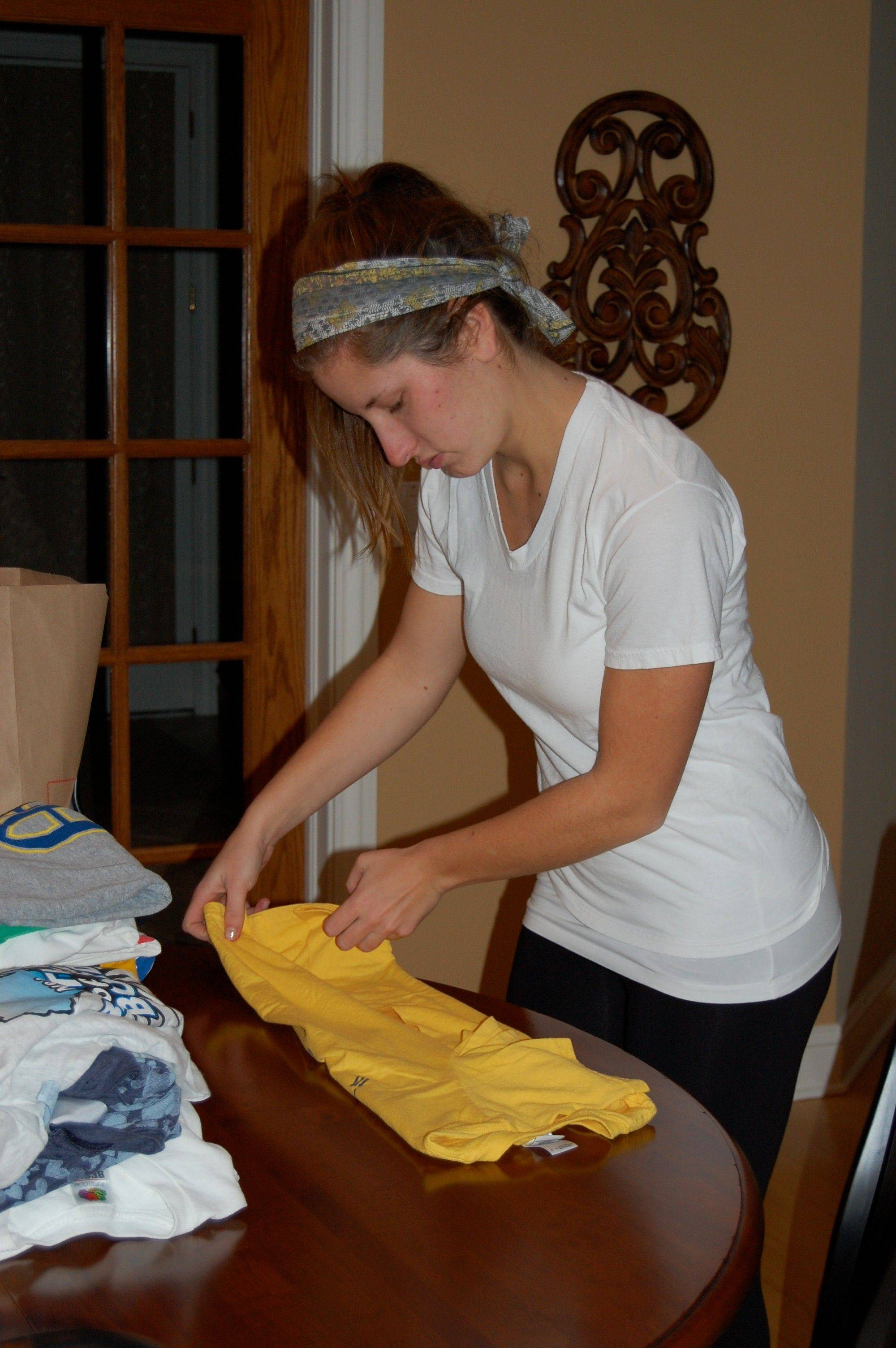 Kayla Mueller, folds T-shirts for a National Honor Society service project.