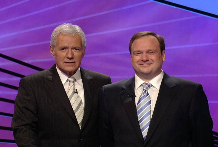 "Arlington Heights resident Tony Fox, right, met with ""Jeopardy!"" host Alex Trebek while competing on the television game show last fall. Fox won his first episode, which appeared Thursday, and will be back to defend his ""Jeopardy!"" title this afternoon."