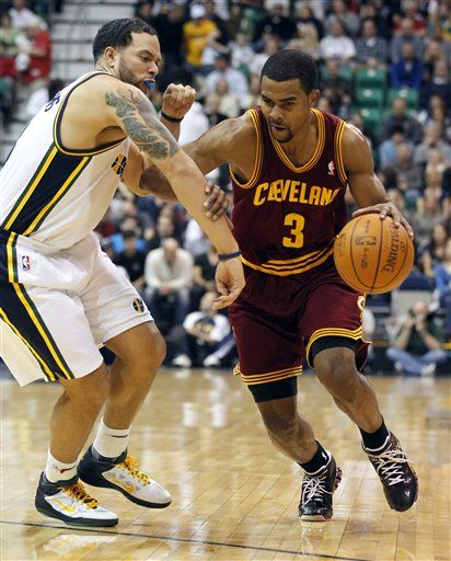 648354a94 Cleveland Cavaliers  Ramon Sessions (3) drives on Utah Jazz s Deron  Williams Friday.