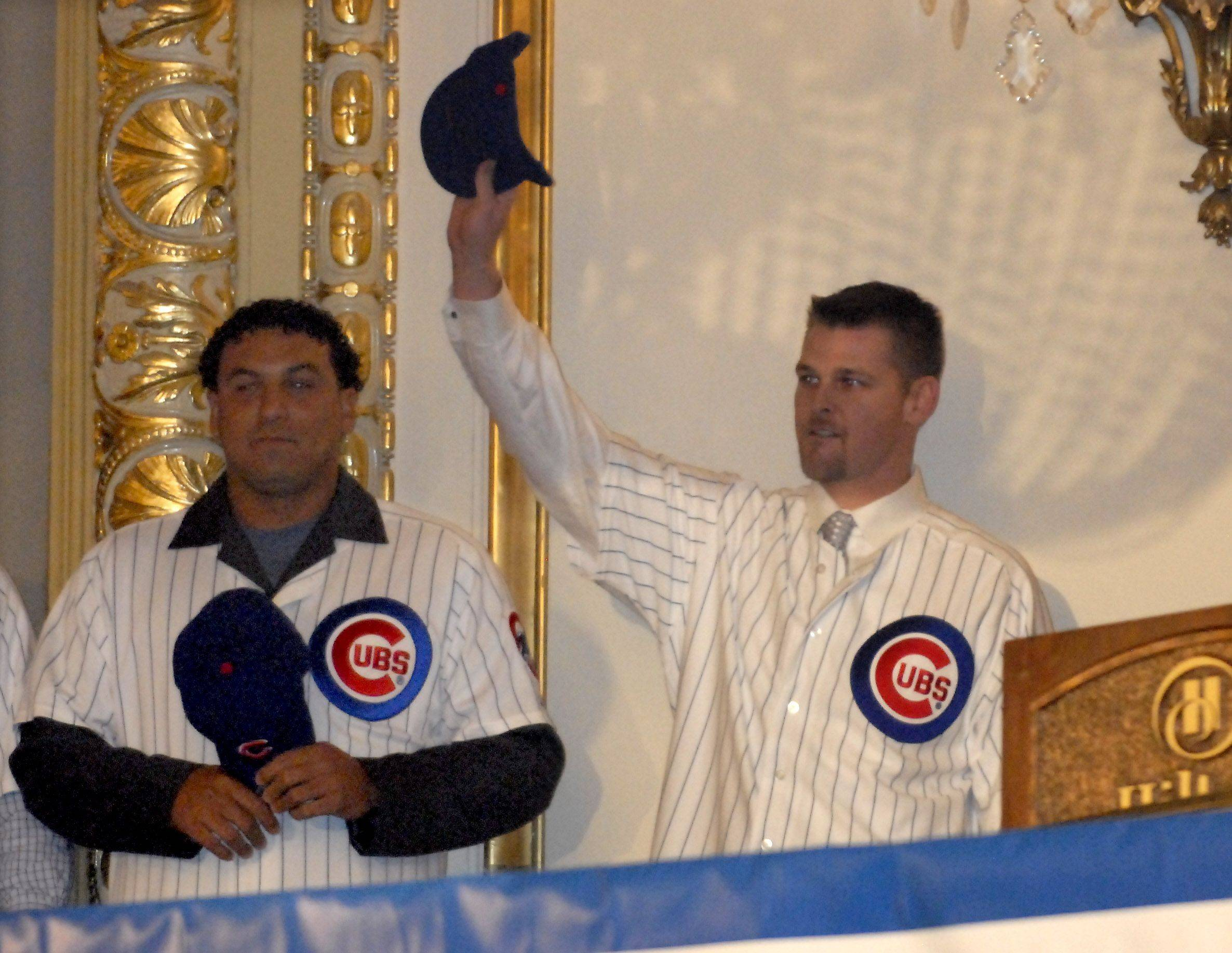 Pitchers Carlos Zambrano and Kerry Wood salute fans.