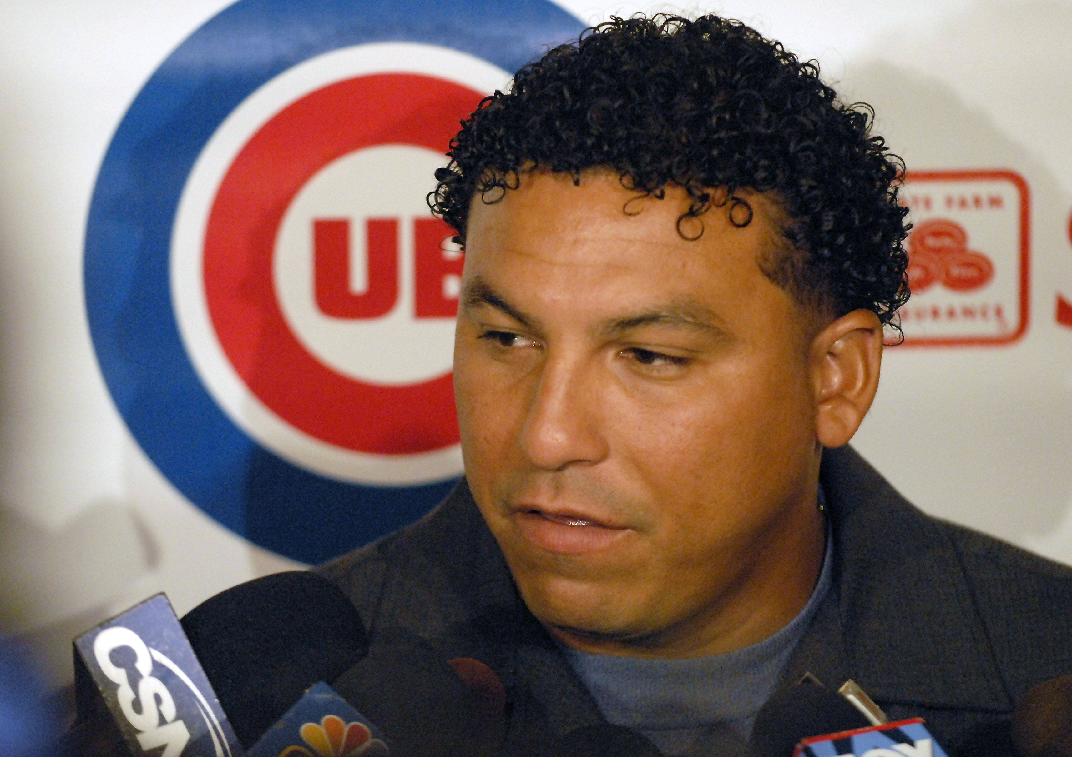 Pitcher Carlos Zambrano talks to the press during the first day of the Cubs convention Friday at the Hilton in Chicago.
