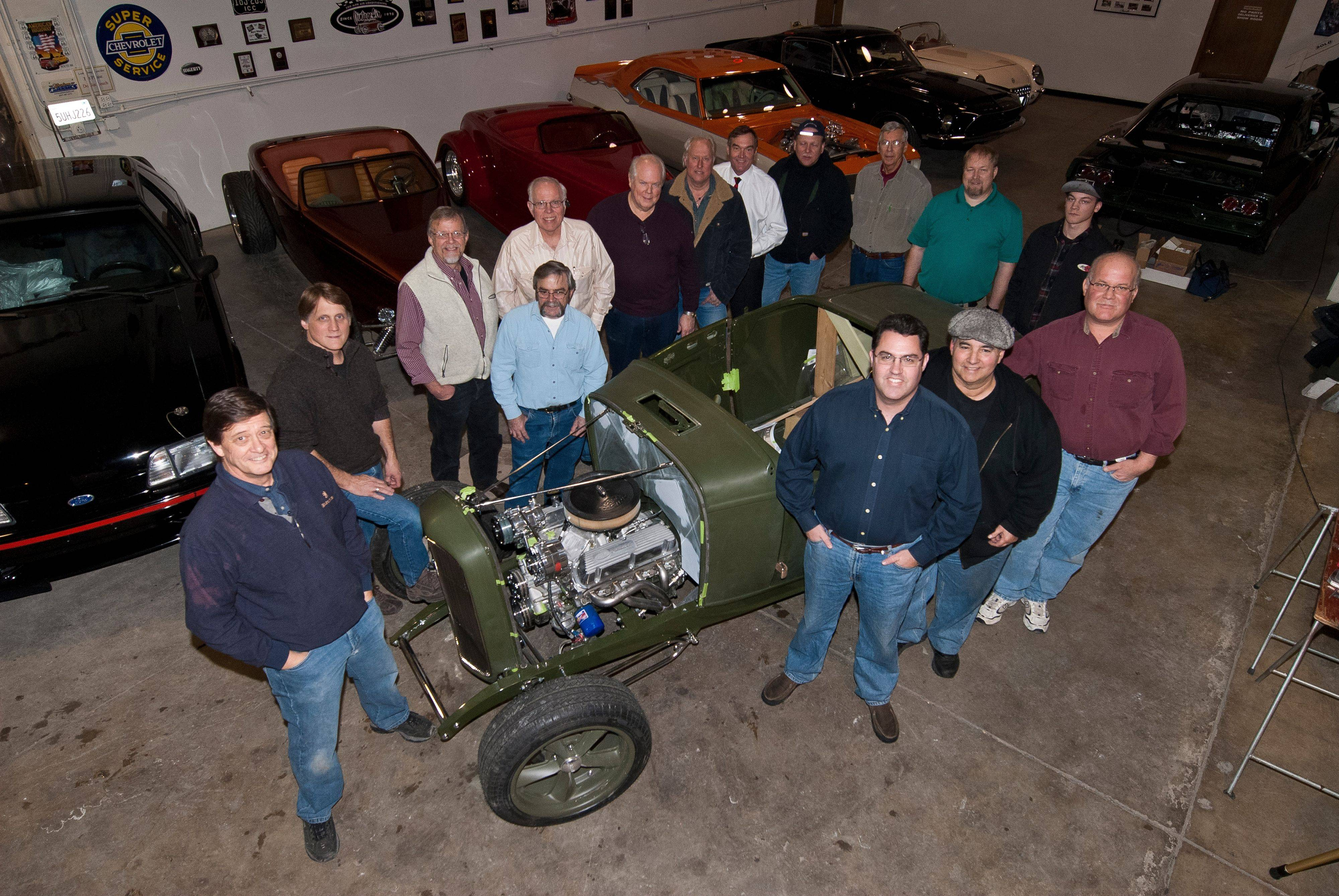 A squadron of volunteers are building a car for charity at Custom Classics Restorations in at Island Lake.