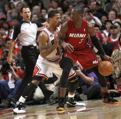 Derrick Rose, who had 34 points, guards the Miami Heat's Dwayne Wade who had 33 points late in the fourth quarter.