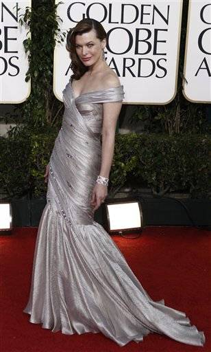 Actress Milla Jovovich arrives at the Golden Globe Awards.