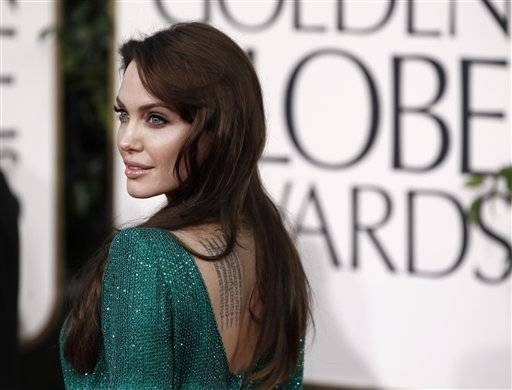 Angelina Jolie poses on the red carpet before the Golden Globe Awards.
