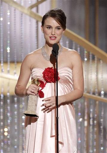 "Natalie Portman accepts the award for Best Actress in a Motion Picture Drama for her role in ""Black Swan""during the Golden Globe Awards."