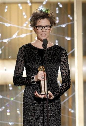 "Actress Annette Bening accepts the award for Best Actress in a Motion Picture Comedy or Musical for her role in ""The Kids Are All Right."""