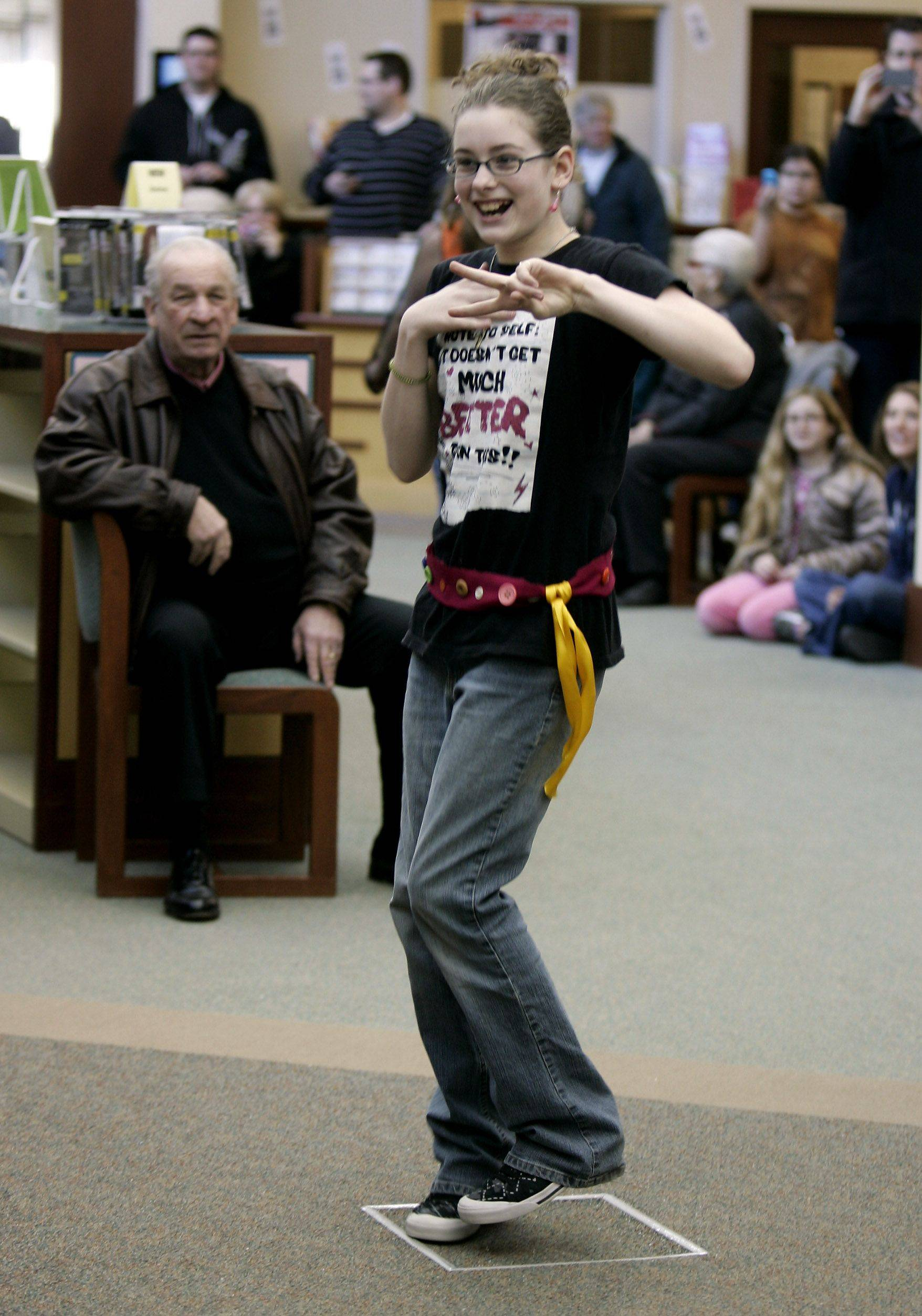 Ellyn Hanna, 12, of Lake Villa shows off her clothes design during the Project Library Fashion Design Challenge Sunday.