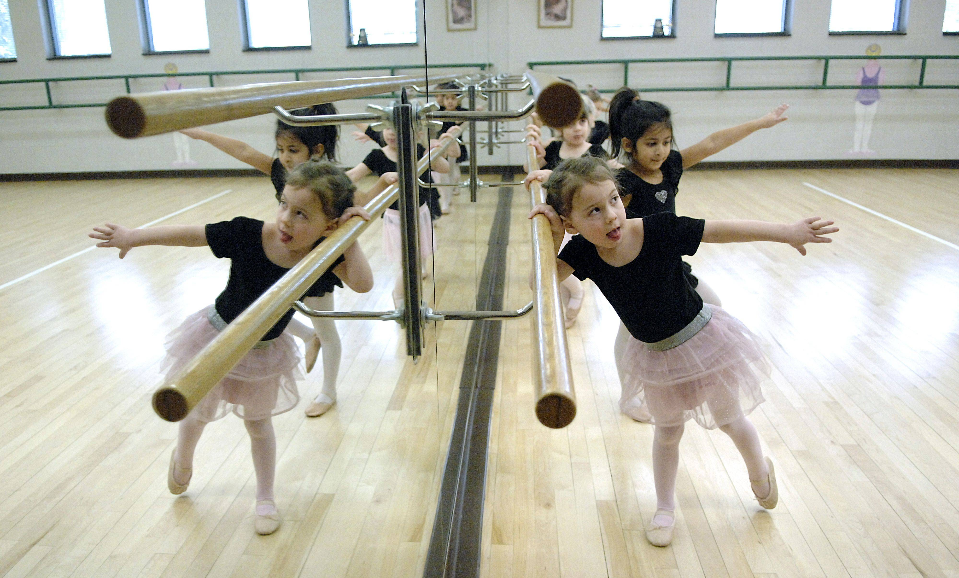 Gabrielle Kozak, 3, of St. Charles practices at the rail with other three and four year olds in the Babes in Ballet class taught by Debbie Studdard at the St. Charles Park District's Pottawatomie Community Center on Thursday, January 13. This is Gabrielle's first ballet class. Babes in Ballet is offered to age groups starting at age three and up to six, and several classes are offered during the week.