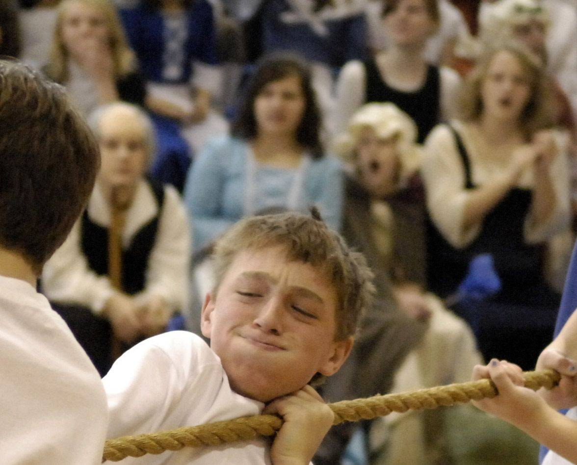 "7th-grader Donny Friedel helps pull his ""blue"" team to victory in the tug-o-war competition during Geneva Middle School North's Patriot Day program Friday."