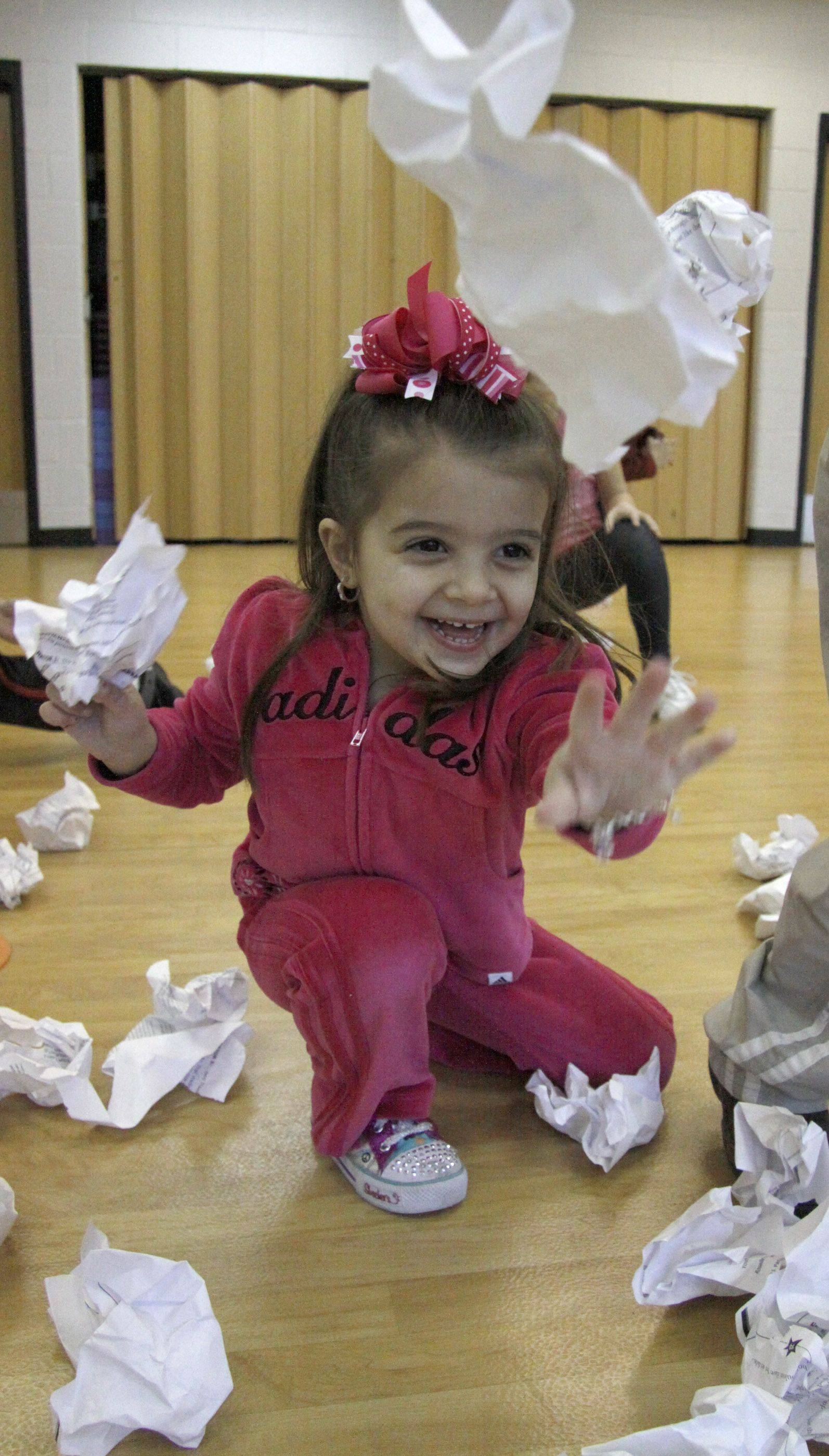 Dominique Gironda, 3, of Roselle throws snowballs Saturday at the Clauss Recreation Center in Roselle.