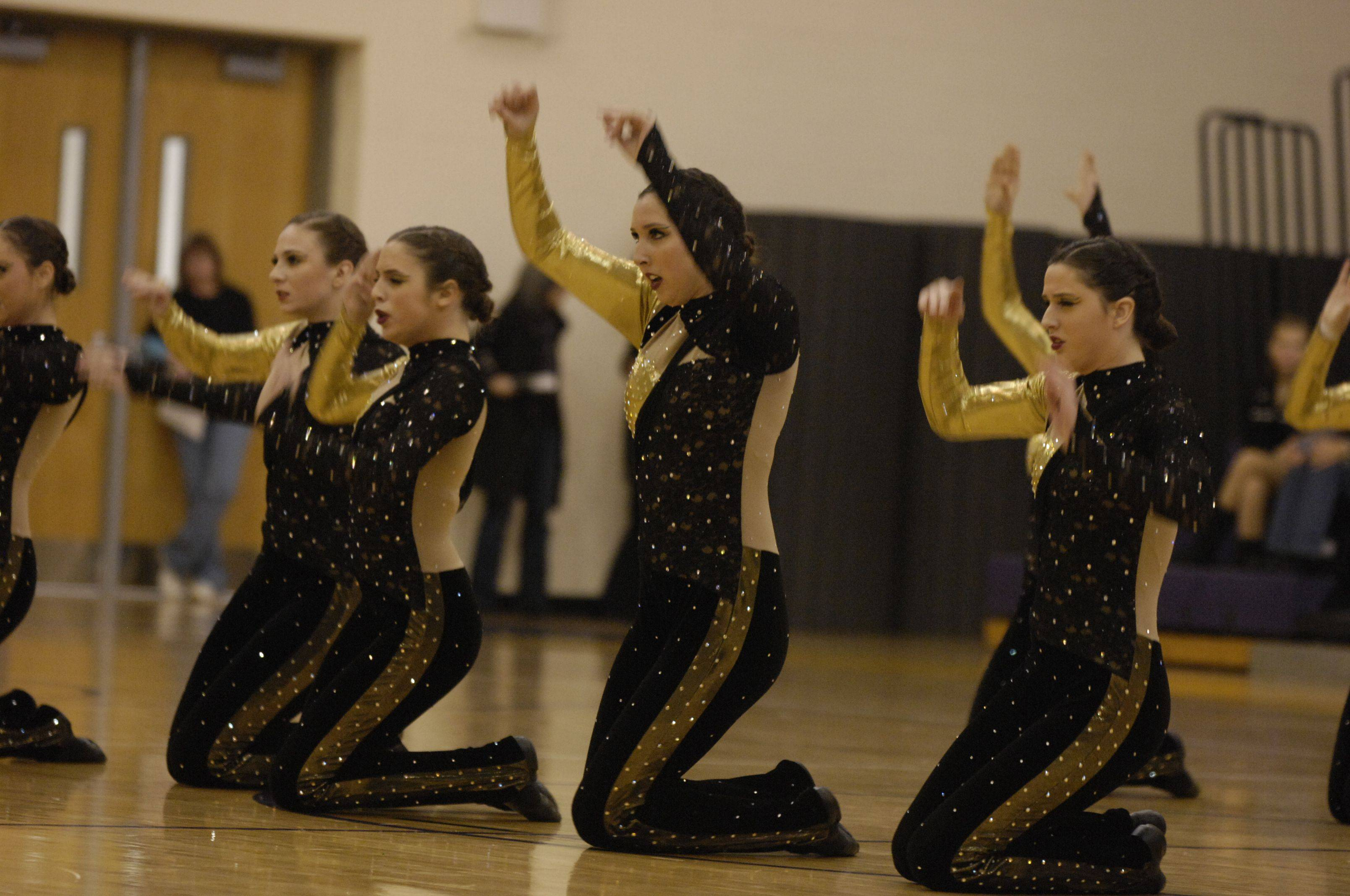 Maine South High School performs in the AAA Kick division during the Team Dance Illinois Wauconda Invitational competition at Wauconda High School.