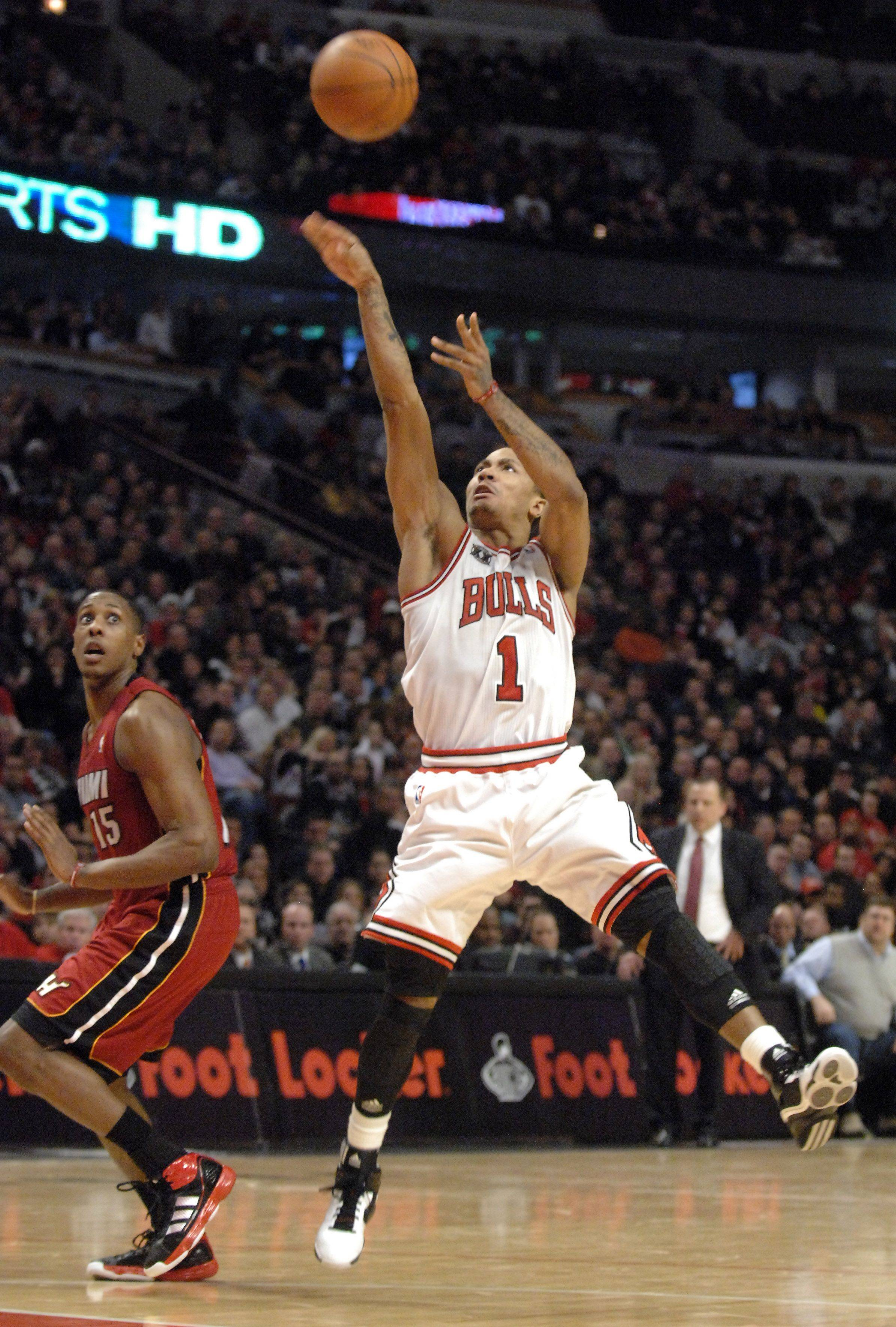 Chicago Bulls point guard Derrick Rose scores and is fouled in the 3rd quarter against Miami during Saturday's game at the United Center in Chicago.