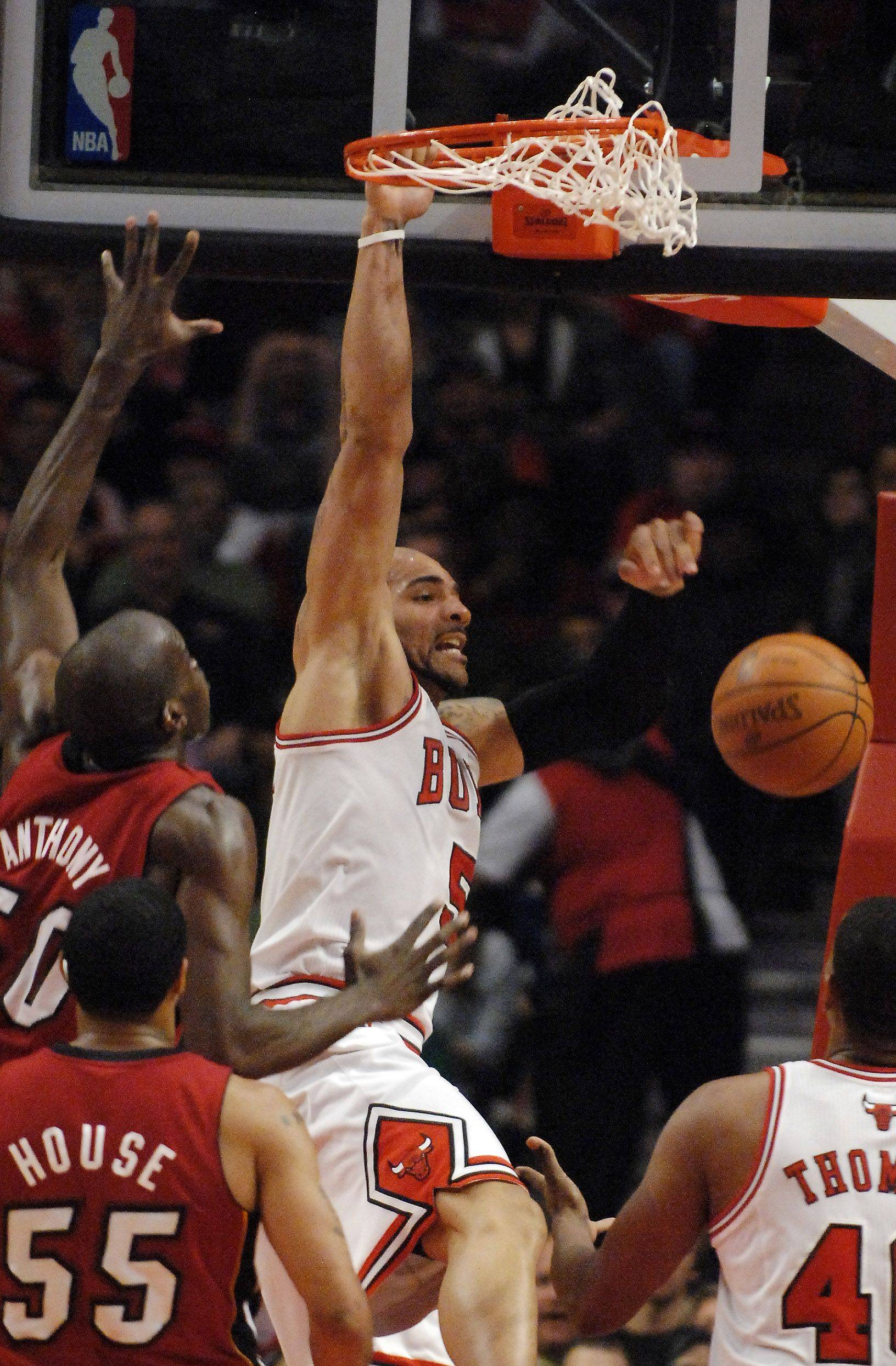 Chicago Bulls power forward Carlos Boozer dunks against Miami during Saturday's game at the United Center in Chicago.