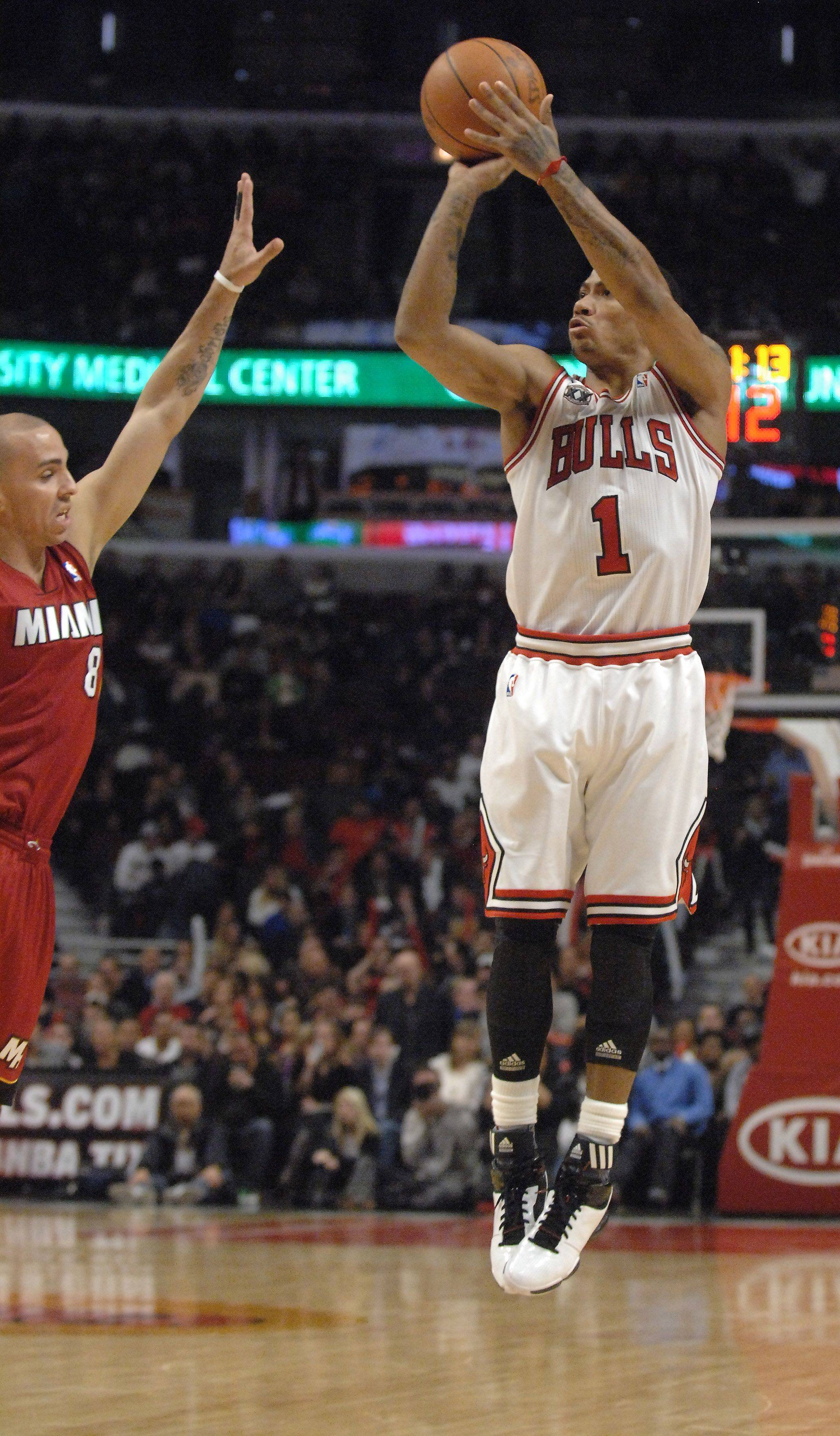 Chicago Bulls point guard Derrick Rose drains one of two 3-pointers he made to start the second half against Miami during Saturday's game at the United Center in Chicago.