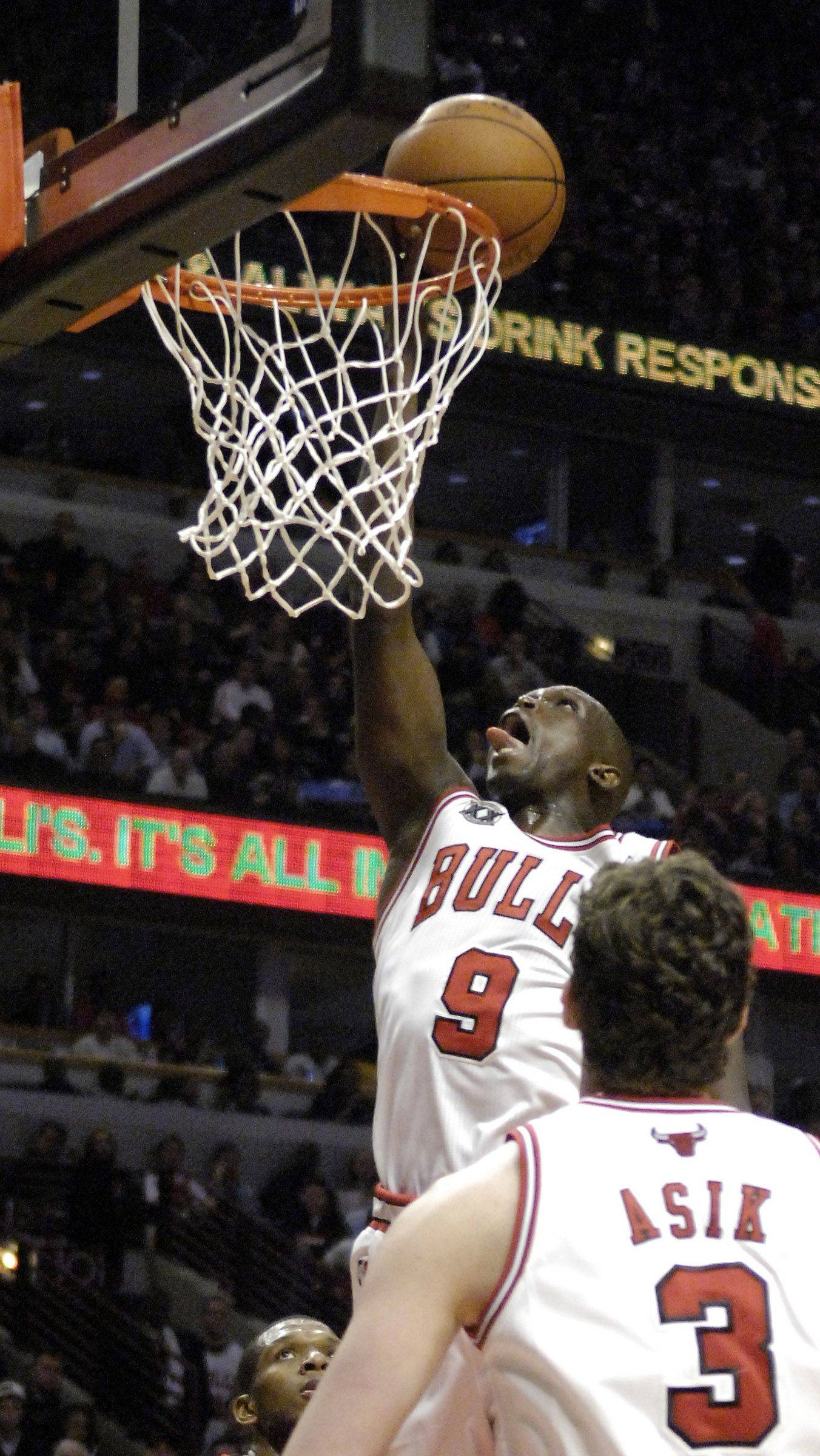 Chicago Bulls small forward Luol Deng lays the ball in during Saturday's game at the United Center in Chicago.