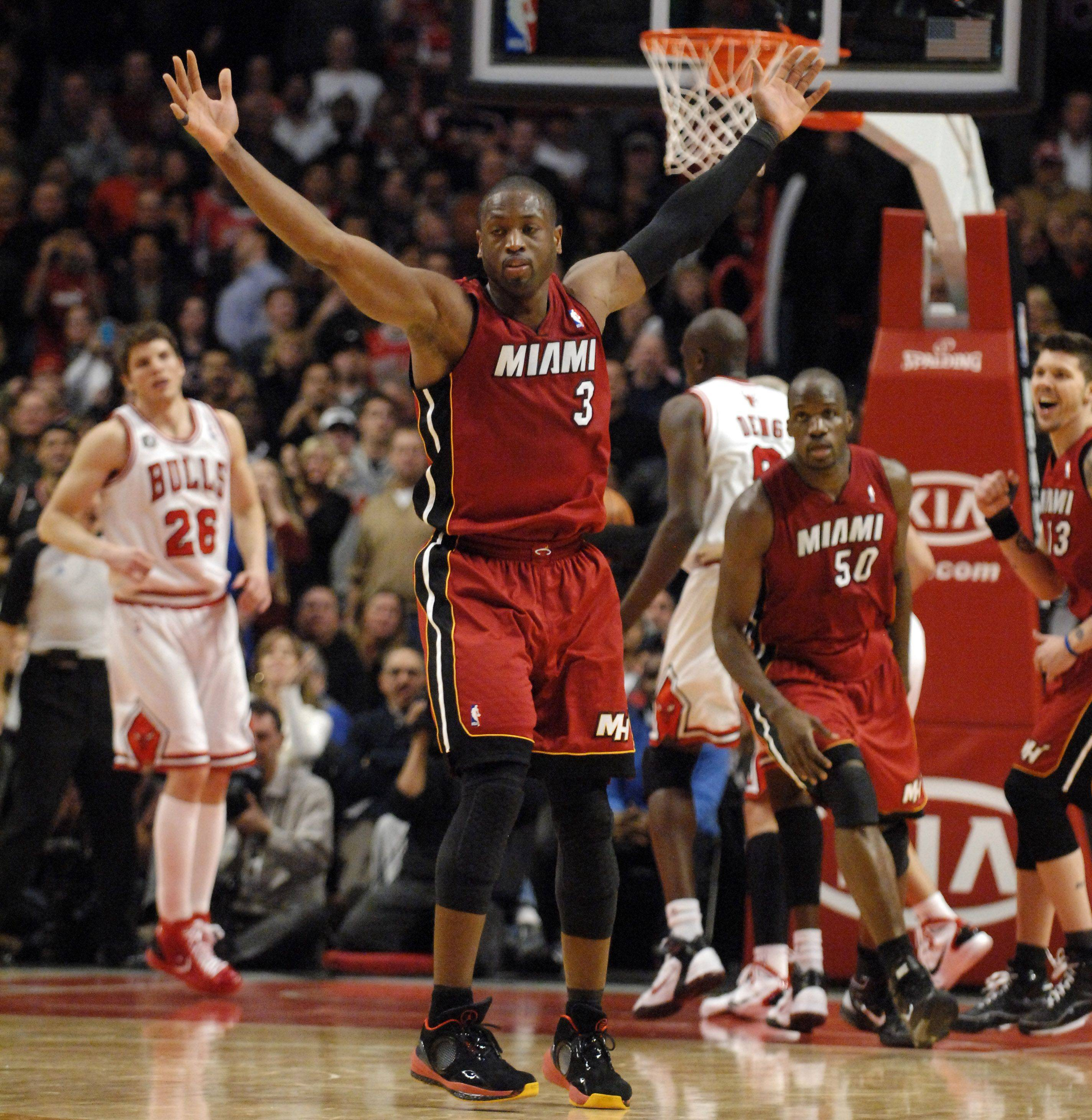 Miami Heat shooting guard Dwyane Wade throws up his hands after a late 3-pointer during Saturday's game at the United Center in Chicago.