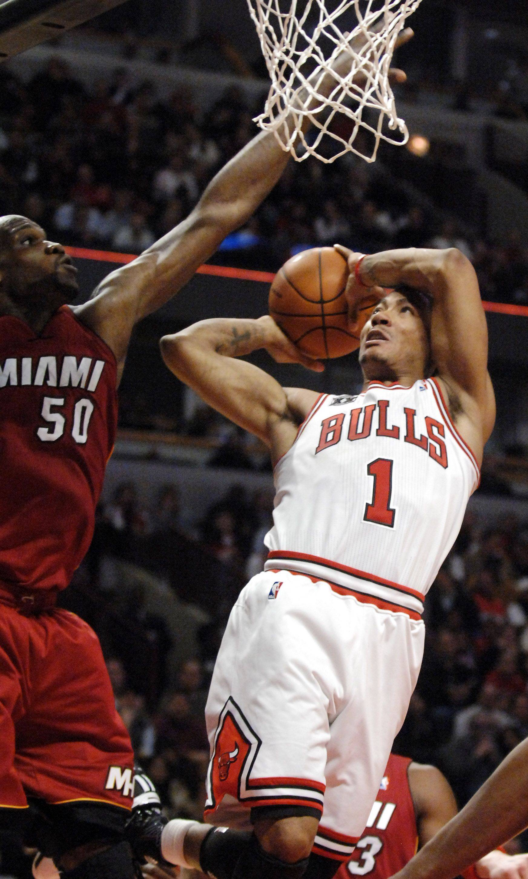 Chicago Bulls point guard Derrick Rose goes to the basket and is defended by Miami Heat center Joel Anthony during Saturday's game at the United Center in Chicago.