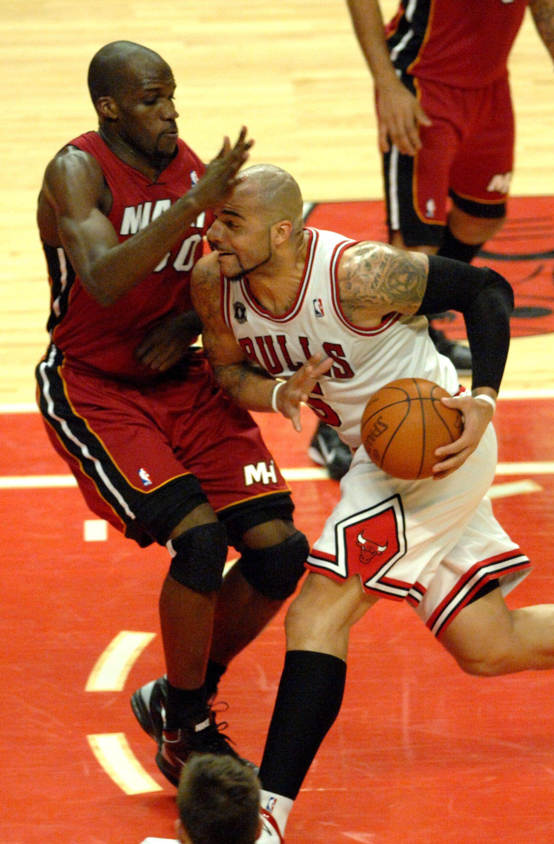 Carlos Boozer drives to the hoop against the defense of Miami's Joel Anthony Saturday night at the United Center.