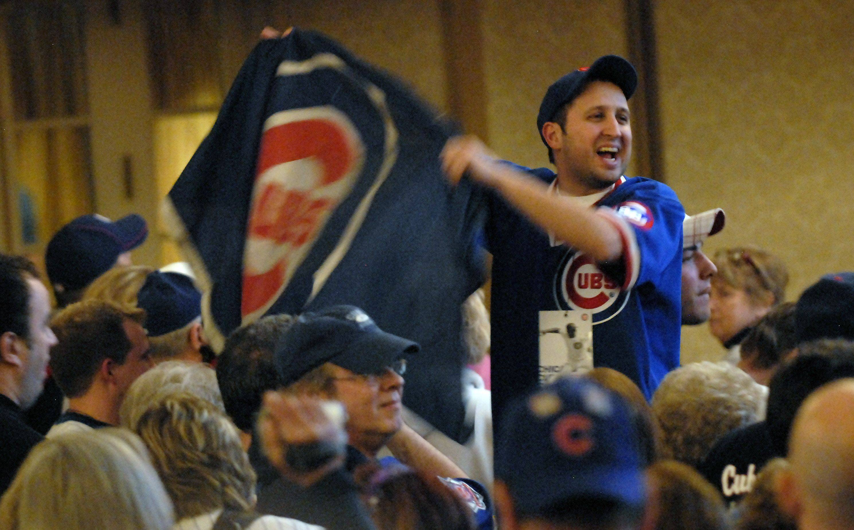 Paul Dzien of Bartlett leads a chant for Ron Santo during the first day of the Cubs convention.