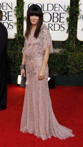 Sandra Bullock arrives for the Golden Globe Awards Sunday, Jan. 16, 2011, in Beverly Hills, Calif. (AP Photo/Matt Sayles)