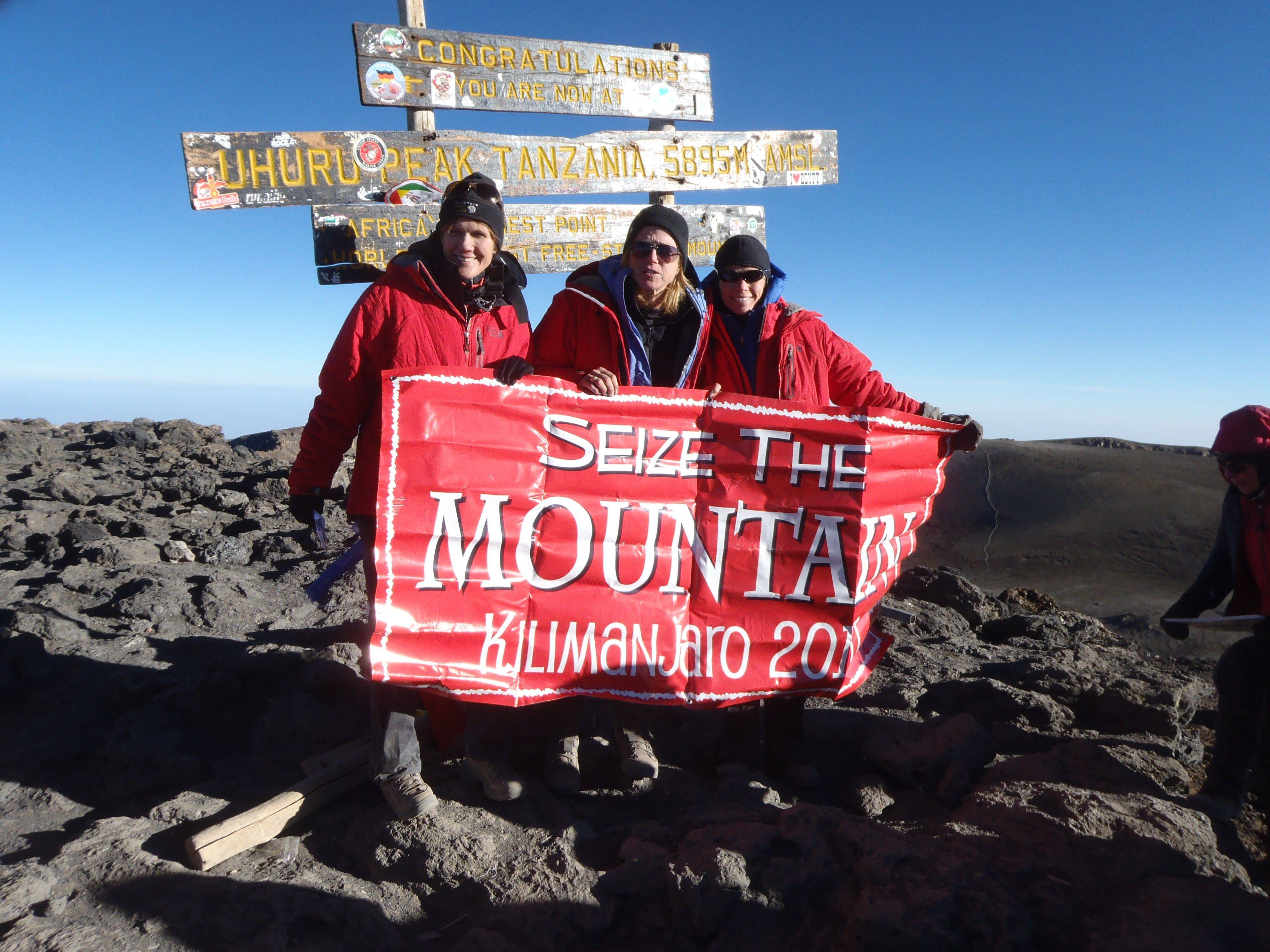 Teri Goudie, center, and her friends, Lisa Stafford, left, and Patty Orler, all of Hinsdale, climbed to the summit of Mount Kilimanjaro in Tanzania. They reached the top Sept. 24, 2010.