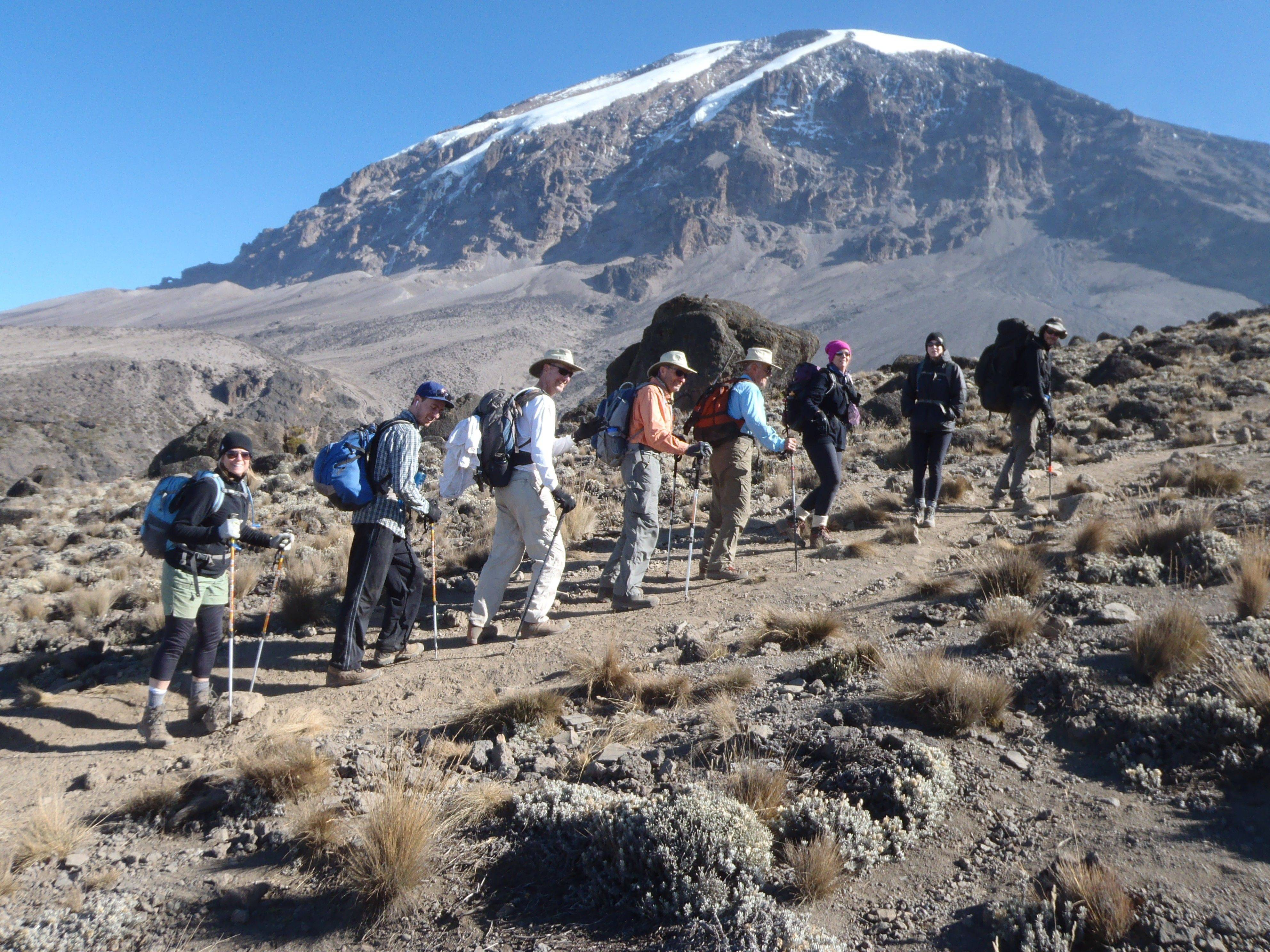 Benet Academy graduate Teri Goudie follows her climbing group up Mount Kilimanjaro in Tanzania. The experience will be part of her presentation to the school's upcoming Mother Daughter Luncheon.