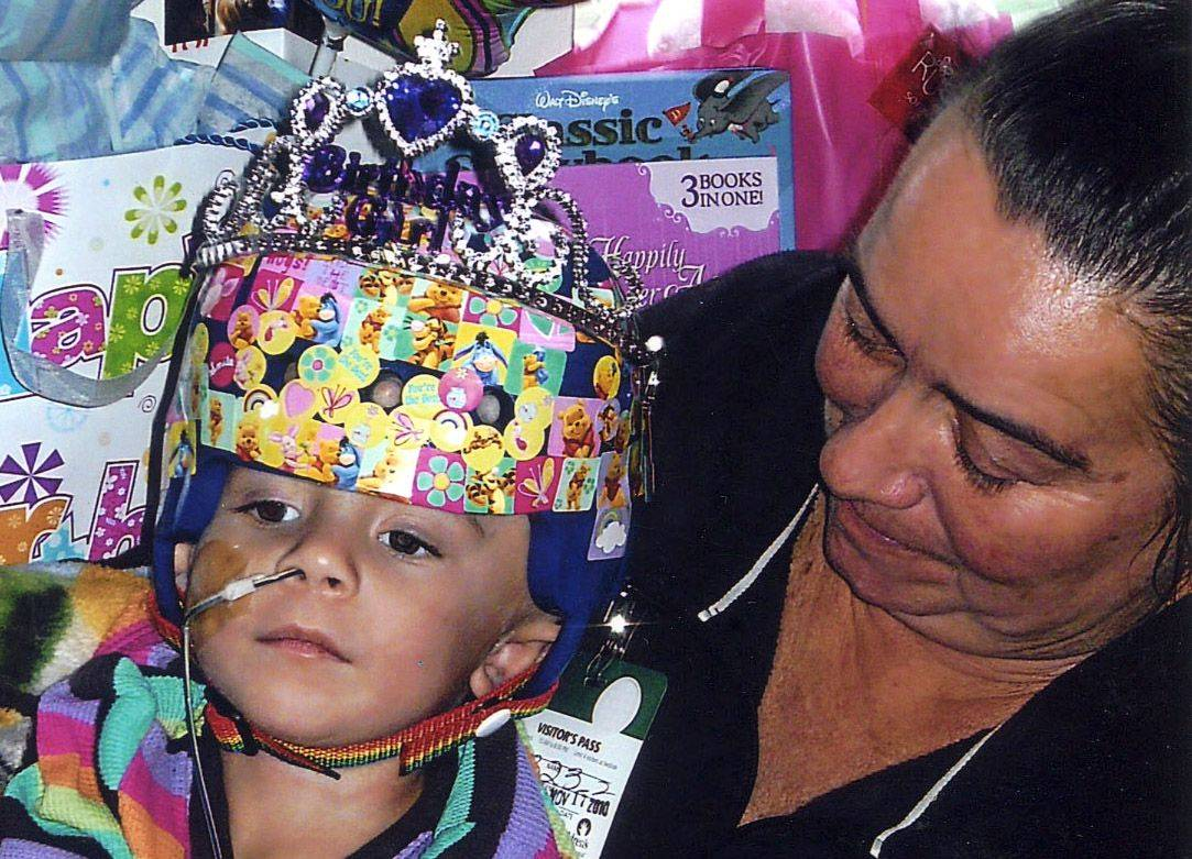 Molly Koch, 2, on her birthday in November at Children's Memorial Hospital. Her grandmother, Carrie Johnson, is with her.